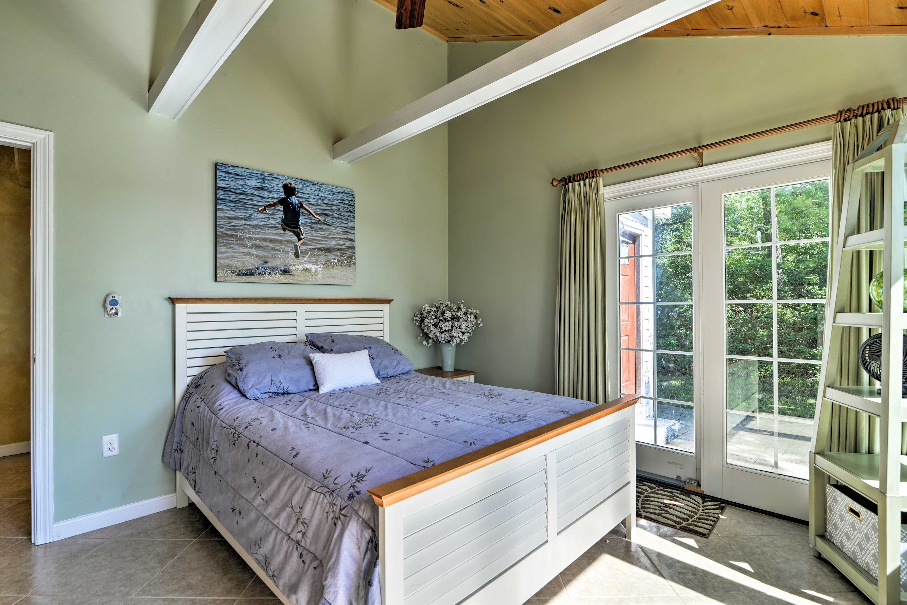 The master bedroom offers a private patio access!