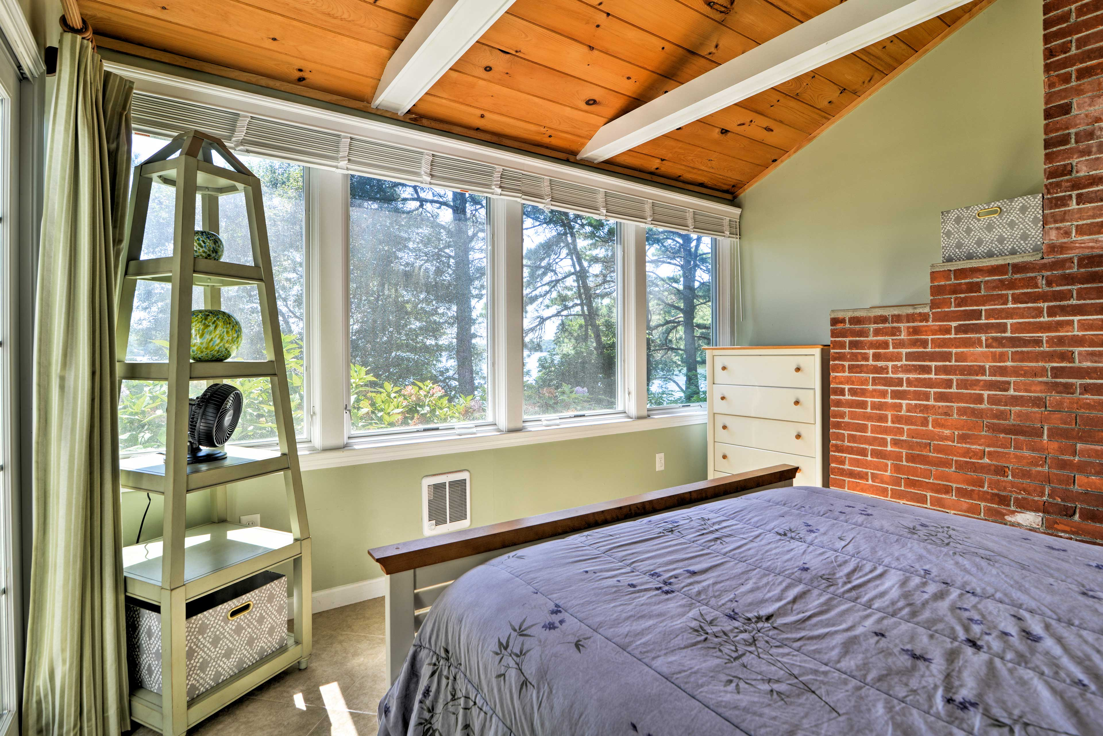 Enjoy wooded views from the comfort of bed!