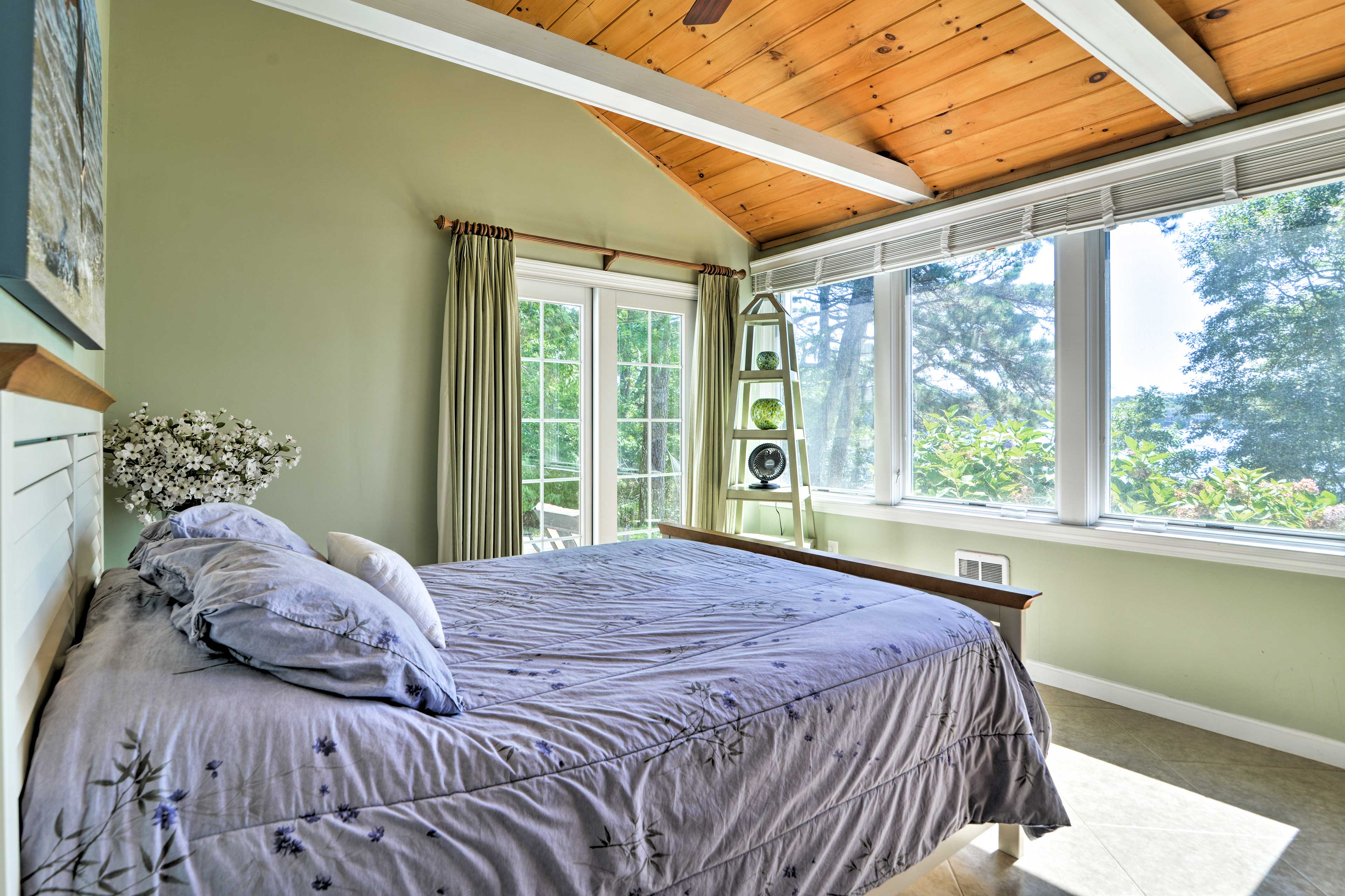 Slip into this cozy queen bed for a peaceful slumber.