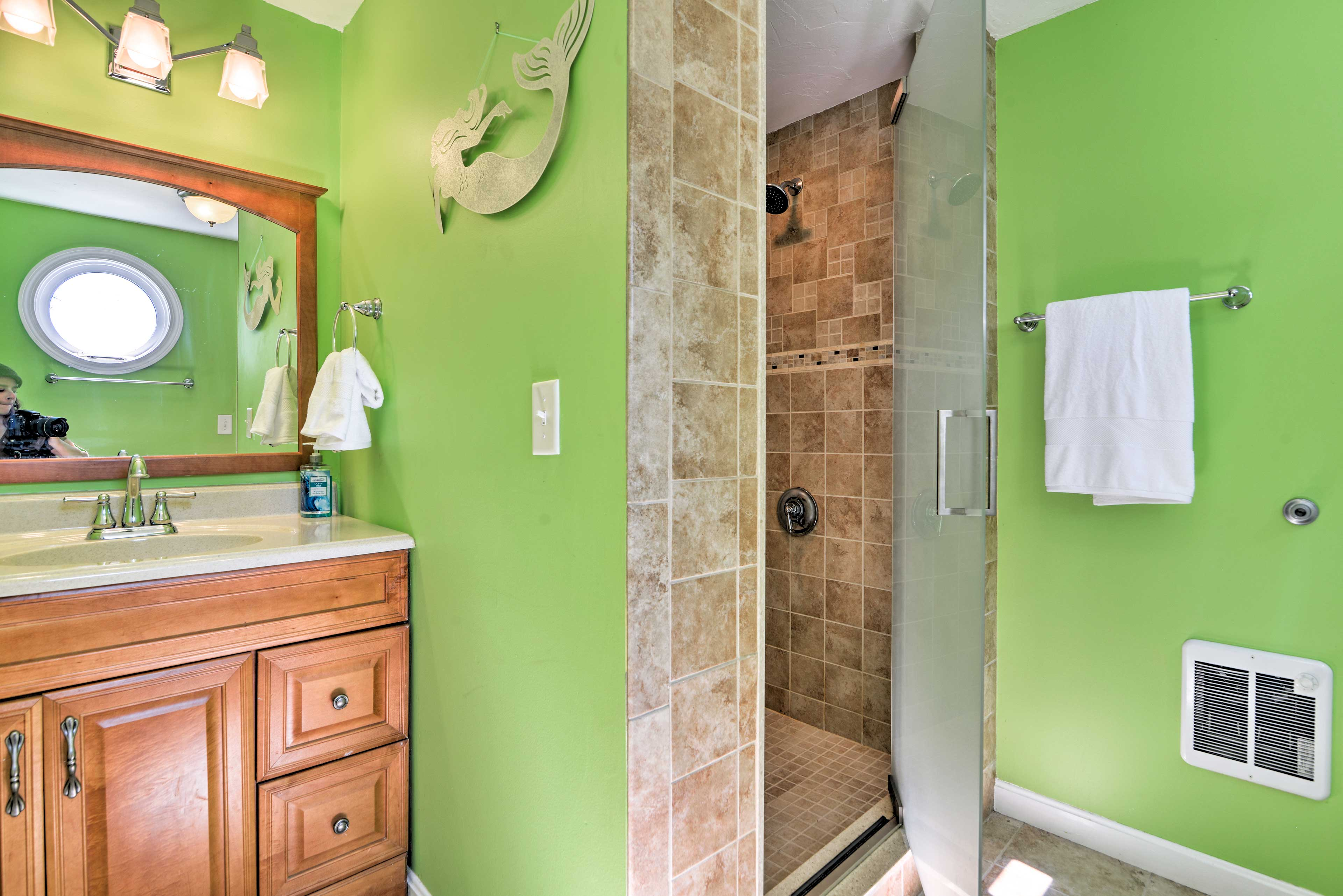 The second bedroom features a walk-in shower.