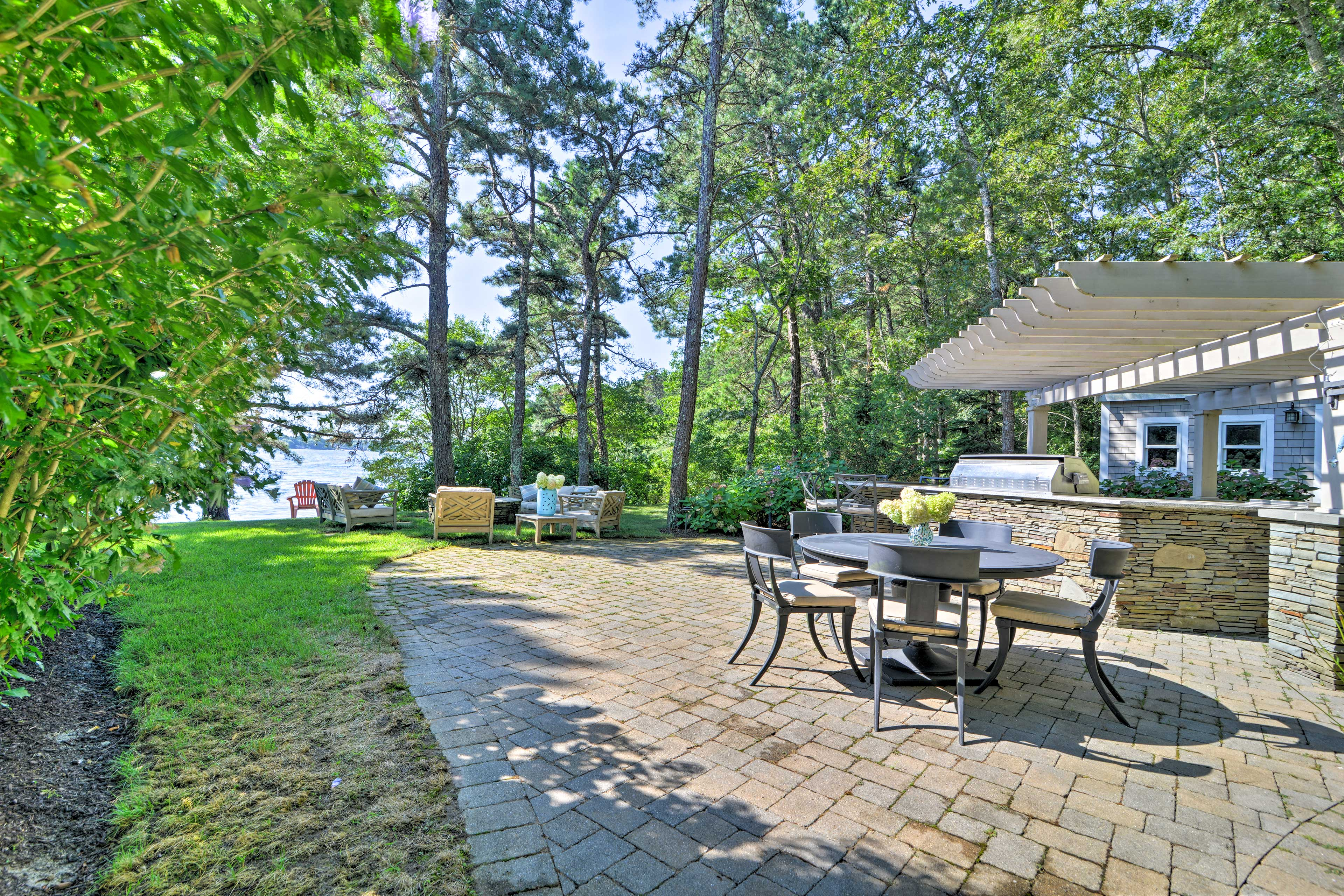 You'll love utilizing the outdoor kitchen and dining set!