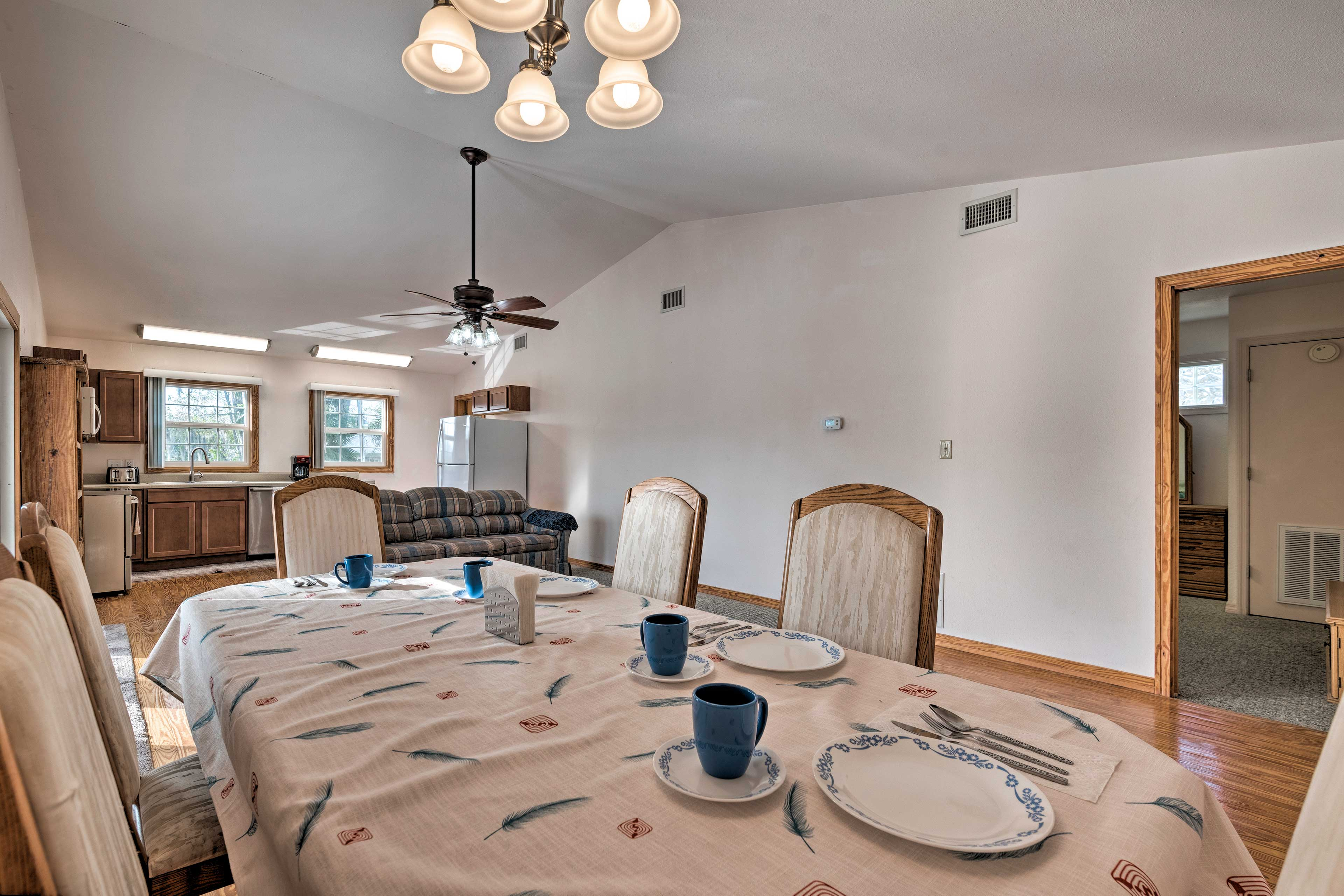 Savor meals together at the 5-person dining table.