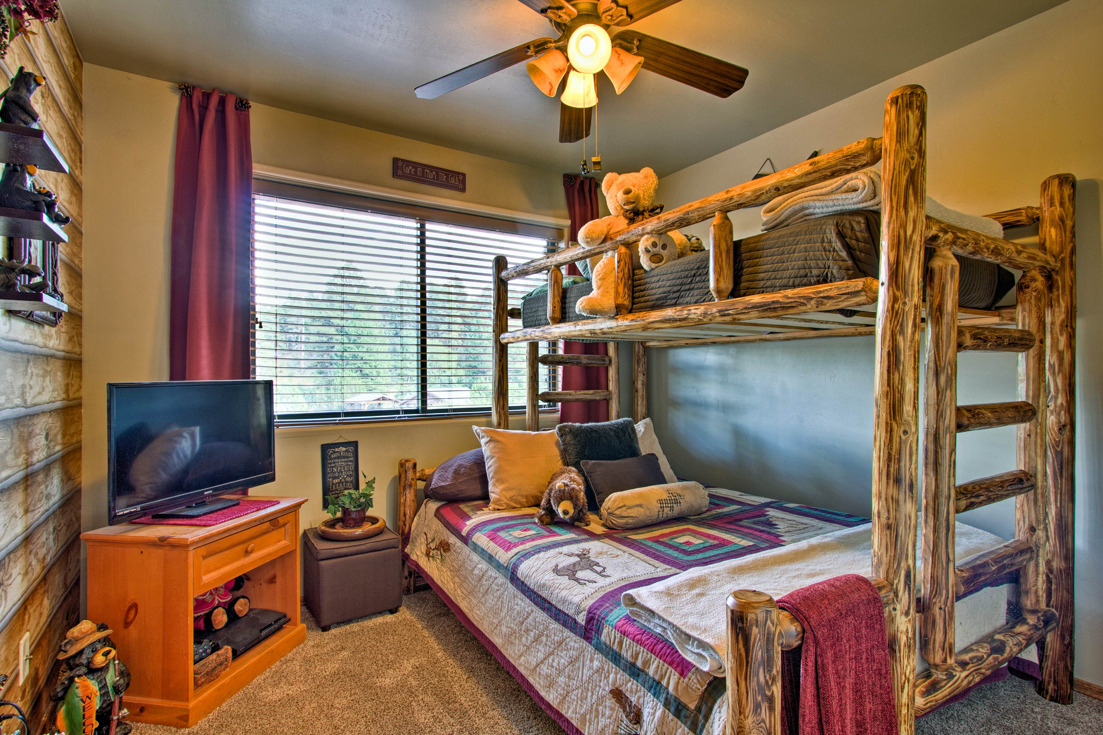 This room features a twin-over-queen bunk bed.