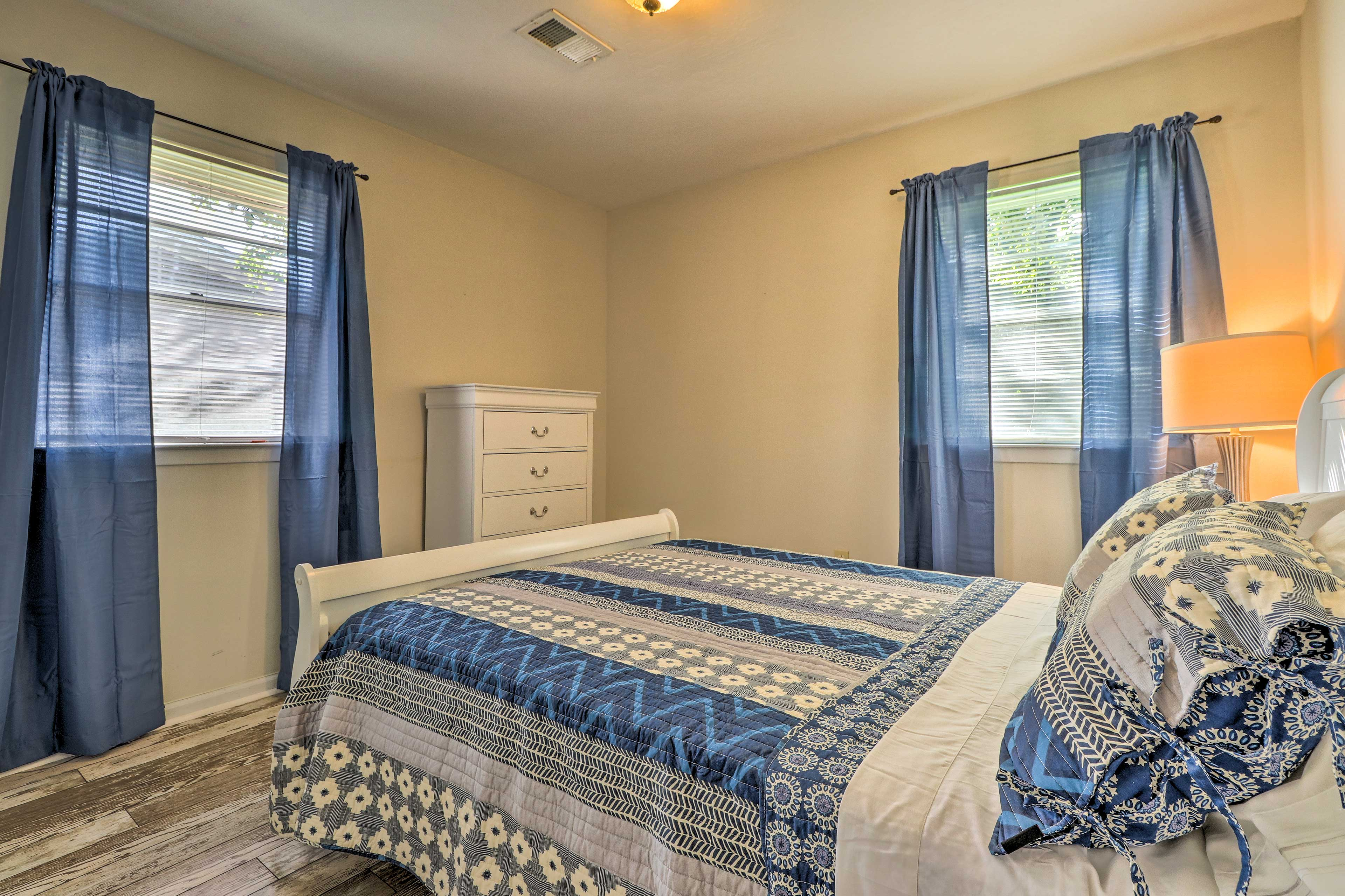 Sleep in late in this charming blue-themed room.