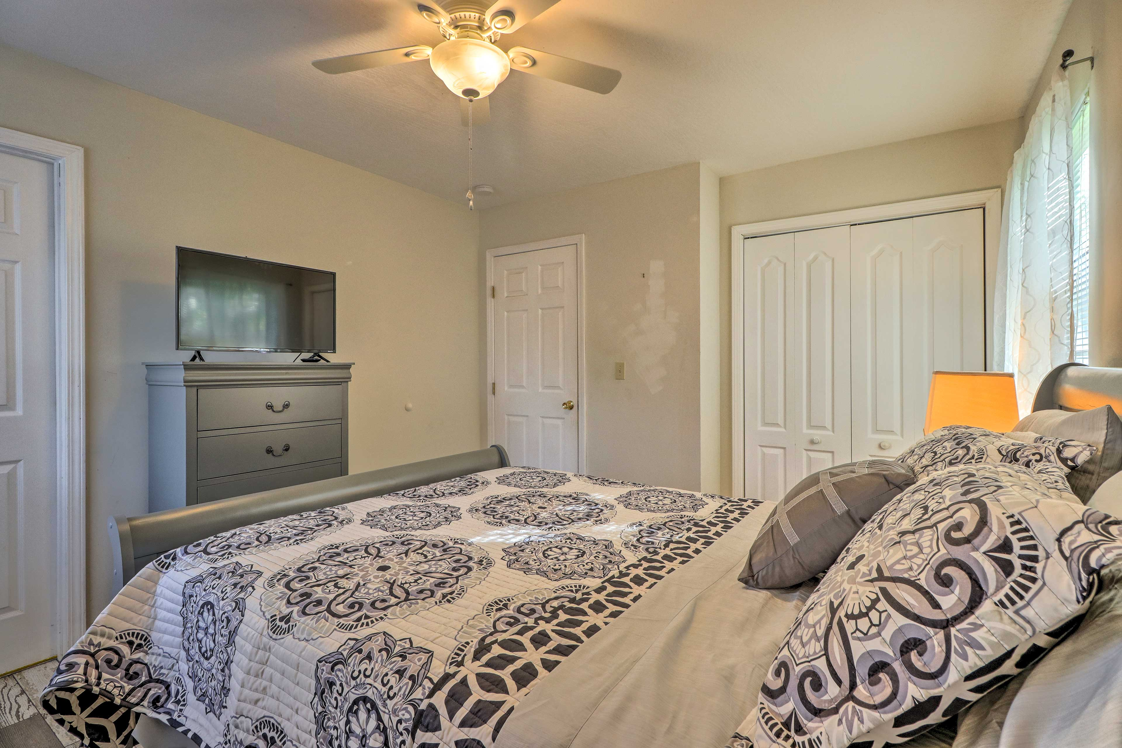 Snuggle up in this queen bed with a movie playing on the flat-screen Smart TV.