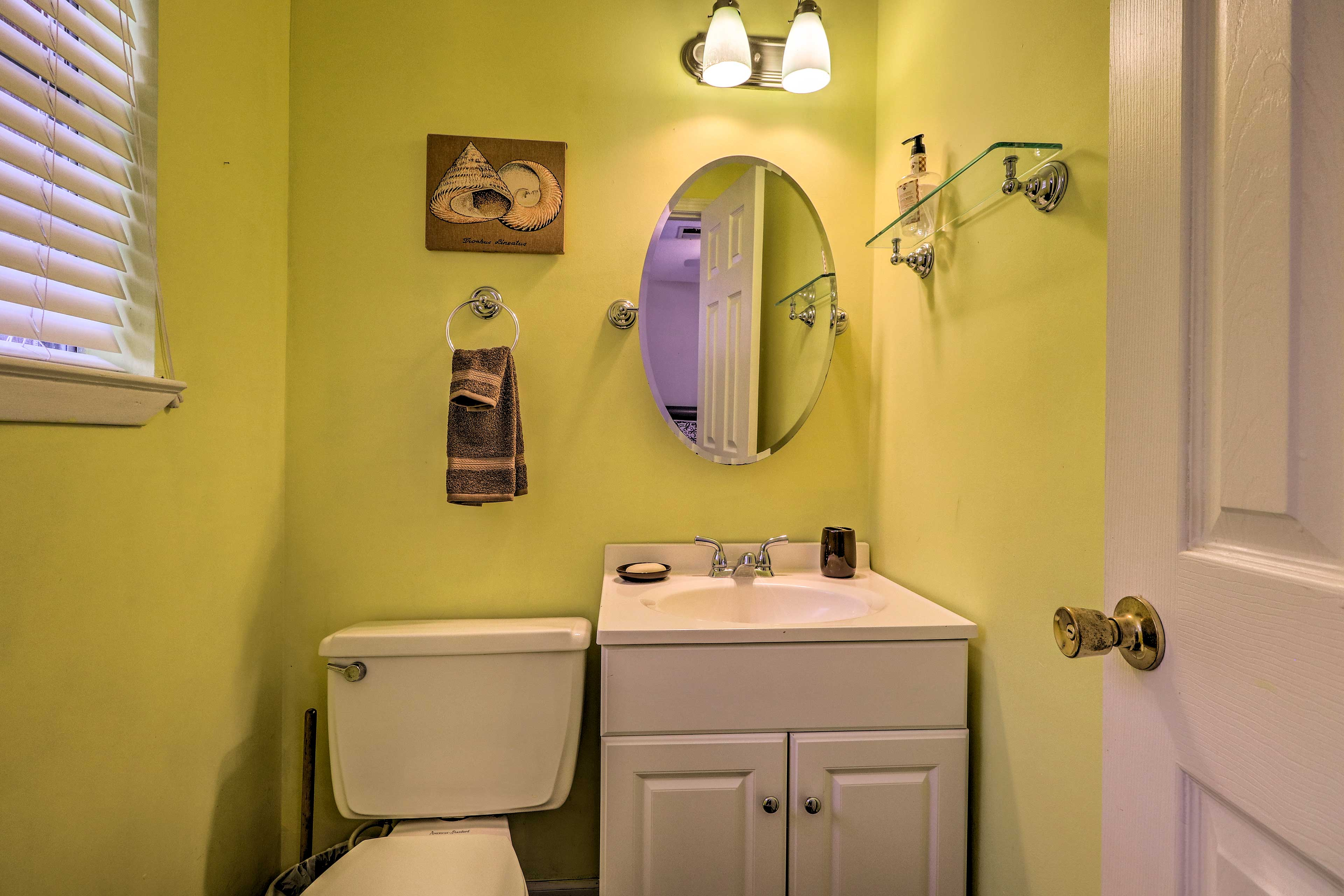 Wash up before dinner in this bright half bath.