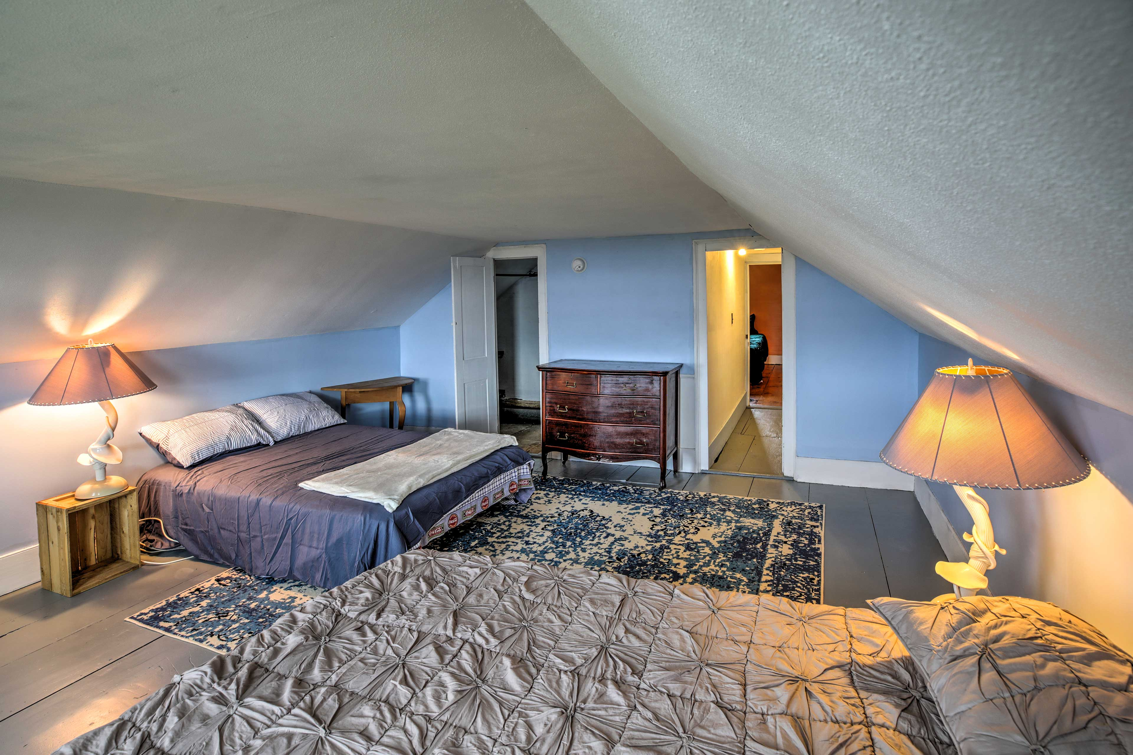 The third bedroom has a queen bed and a full bed.