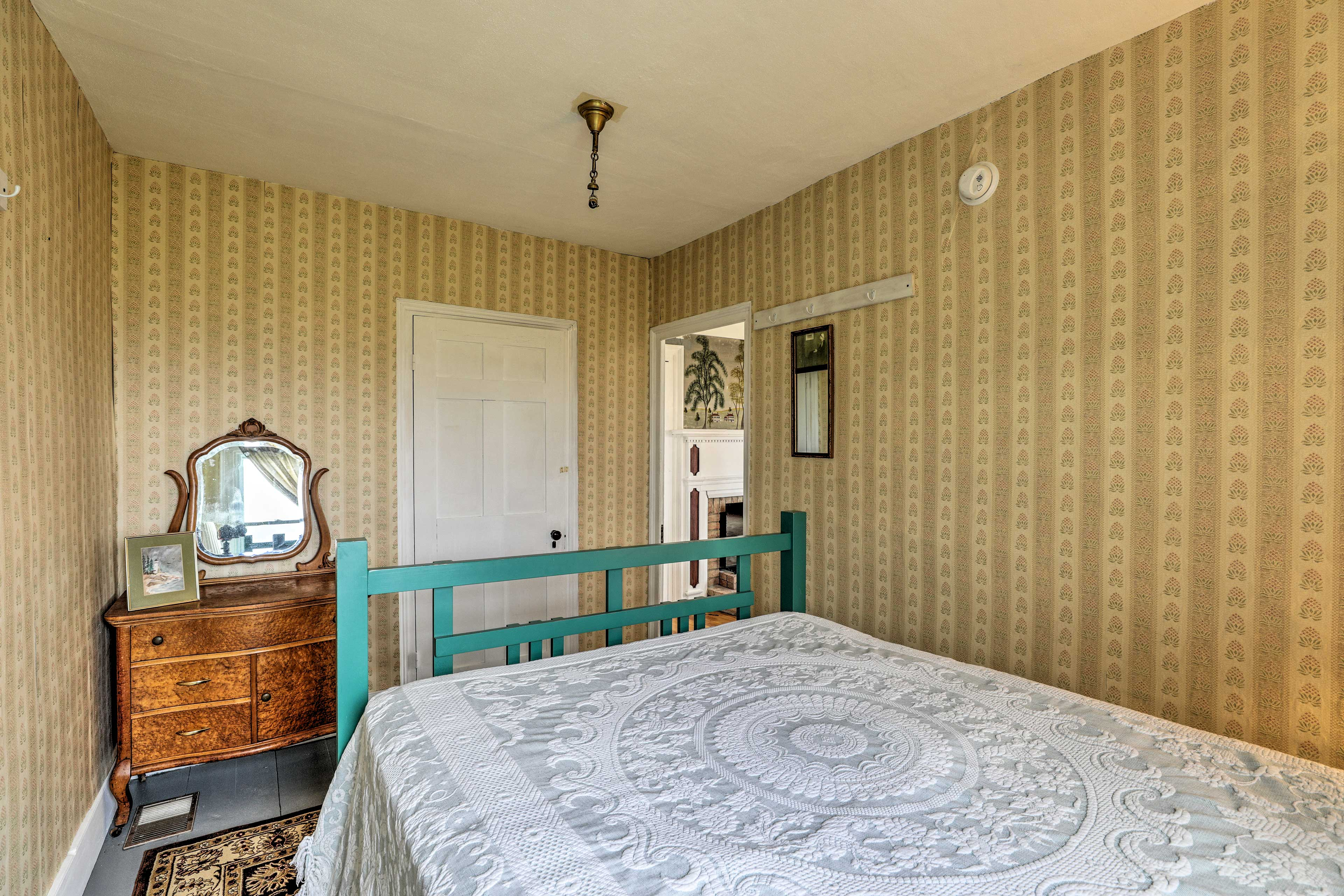 This bedroom also has a nightstand for getting ready each morning.