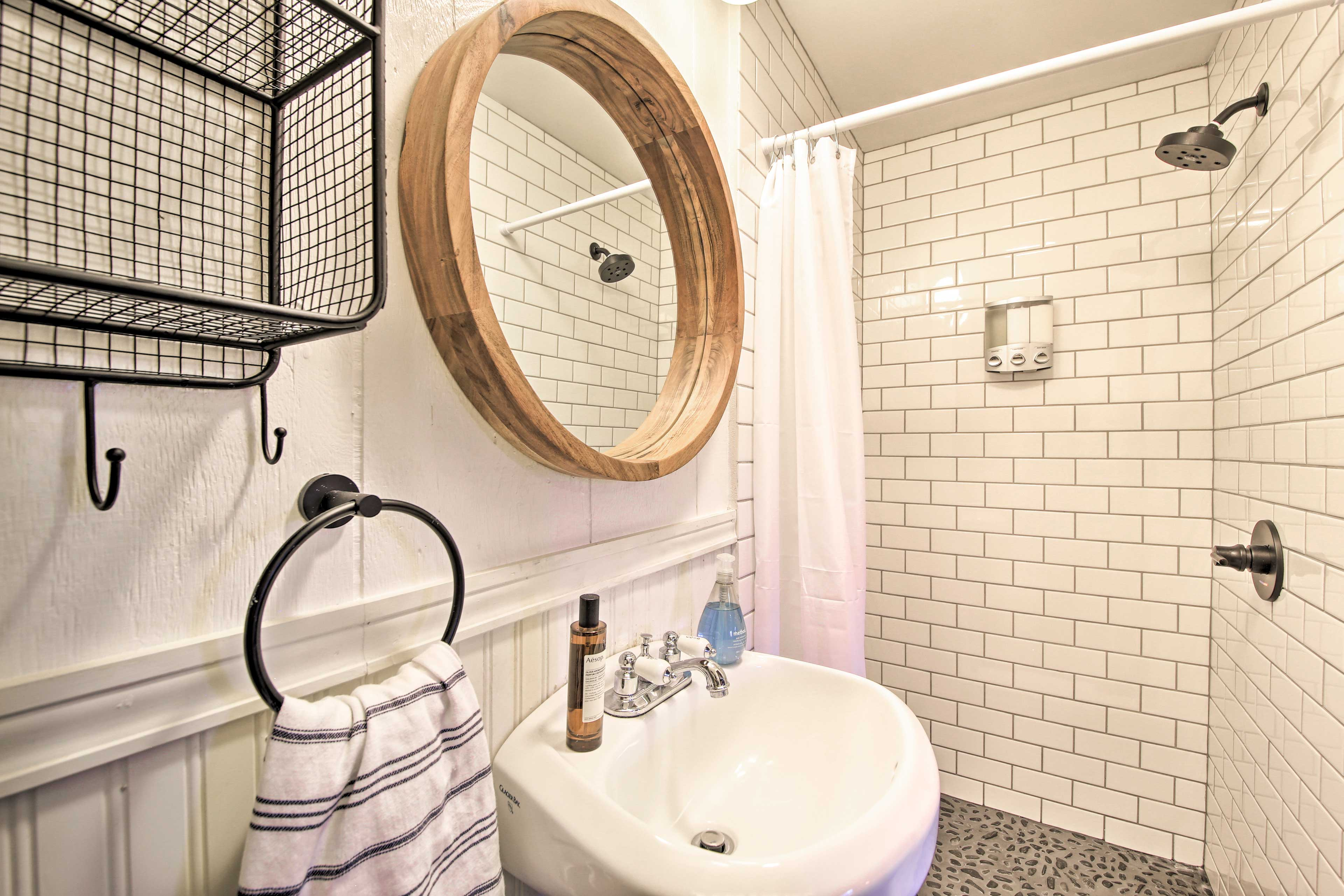 The bathroom downstairs is a full with a walk-in shower.
