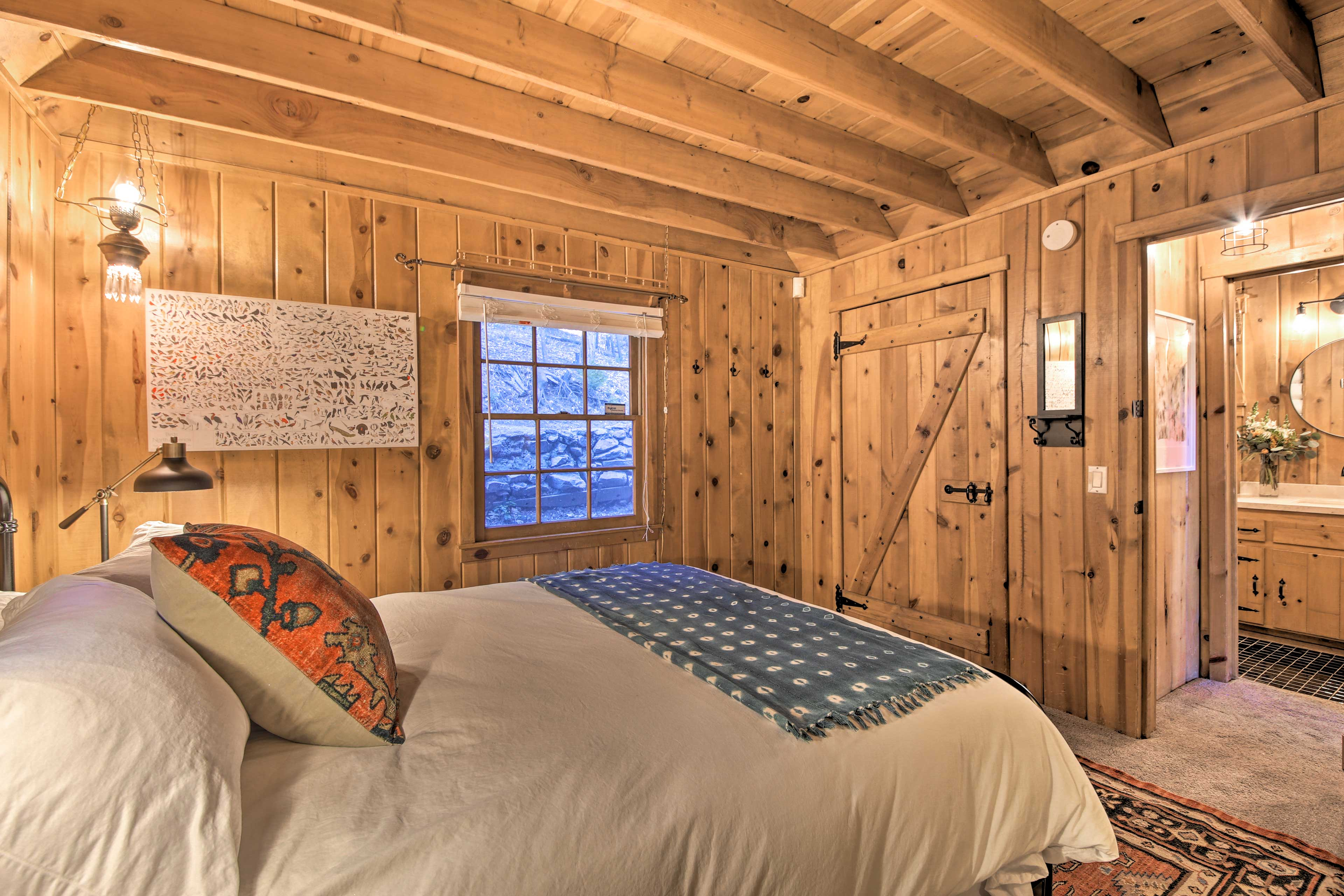 The master bedroom boasts a luxurious queen bed.