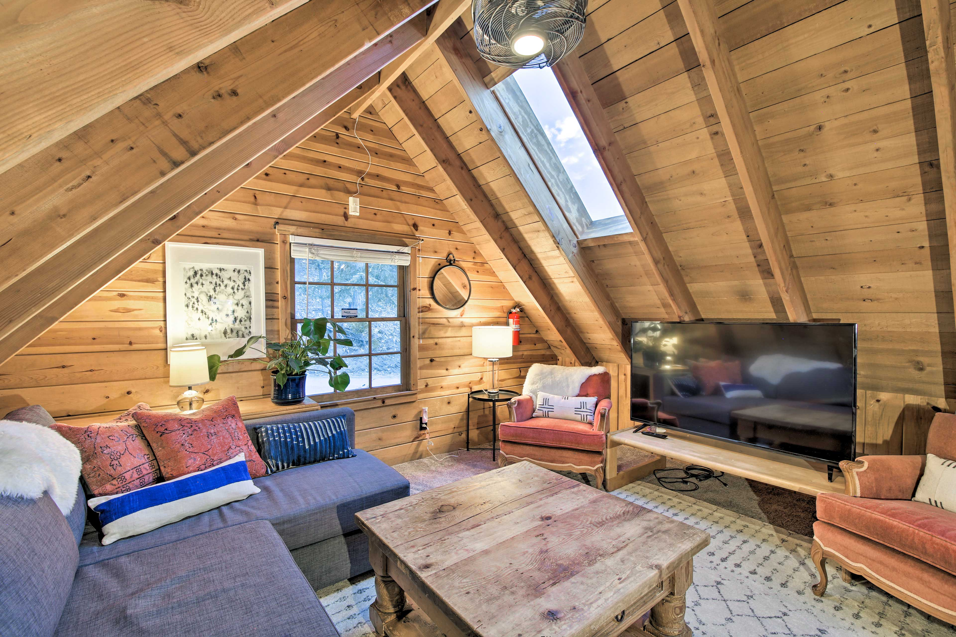 Relax in the loft area in front of the large Smart TV.