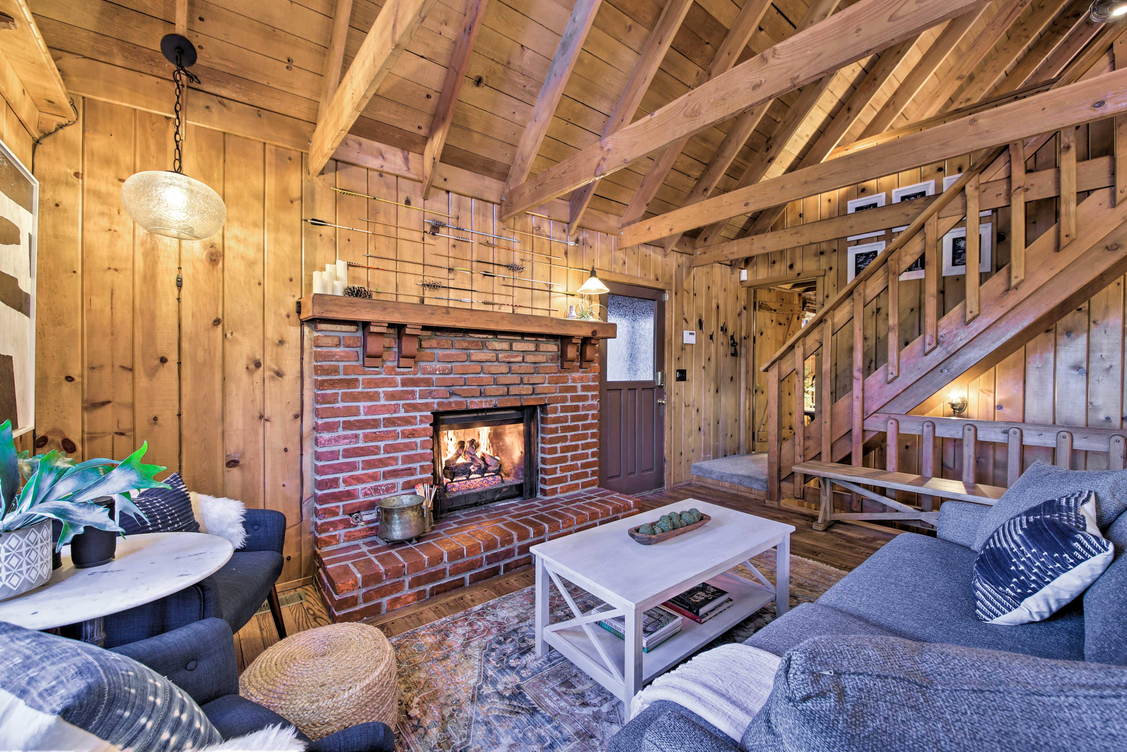 Note the intricate arrow design above the rustic fireplace.
