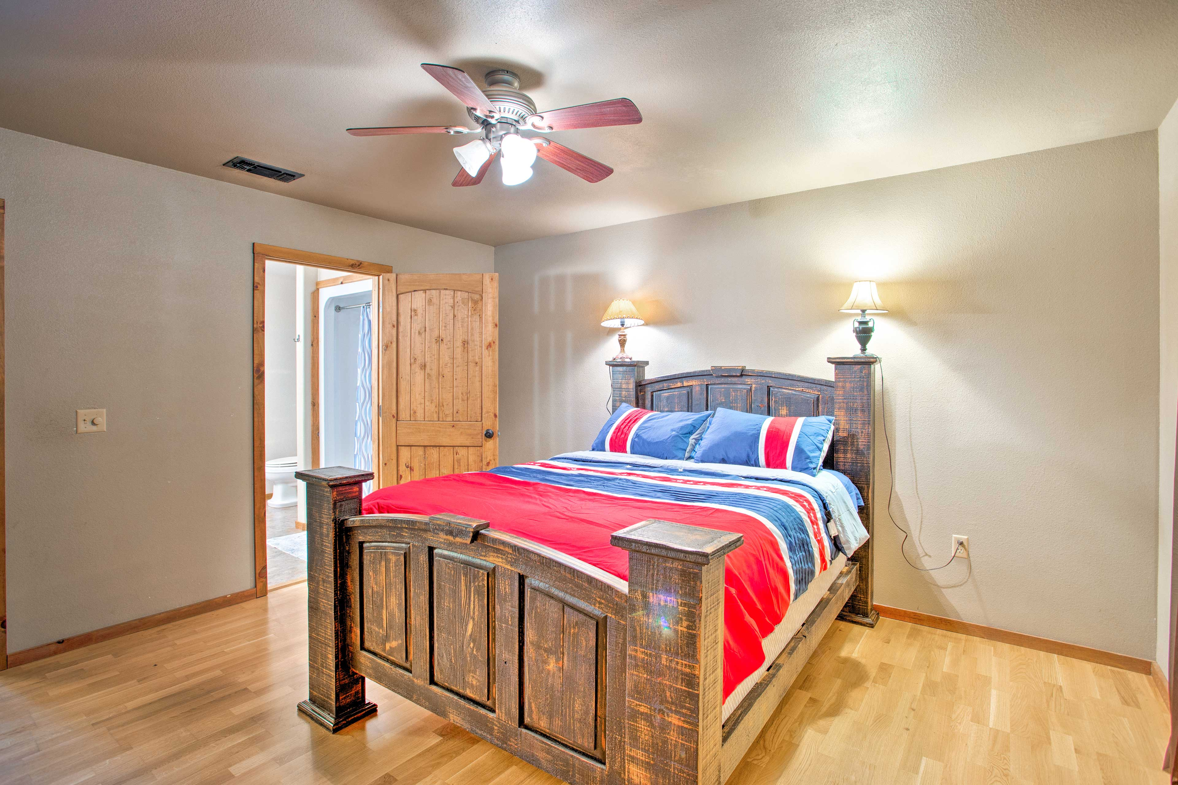 Allow the ceiling fan's cool breeze to lull you to sleep.