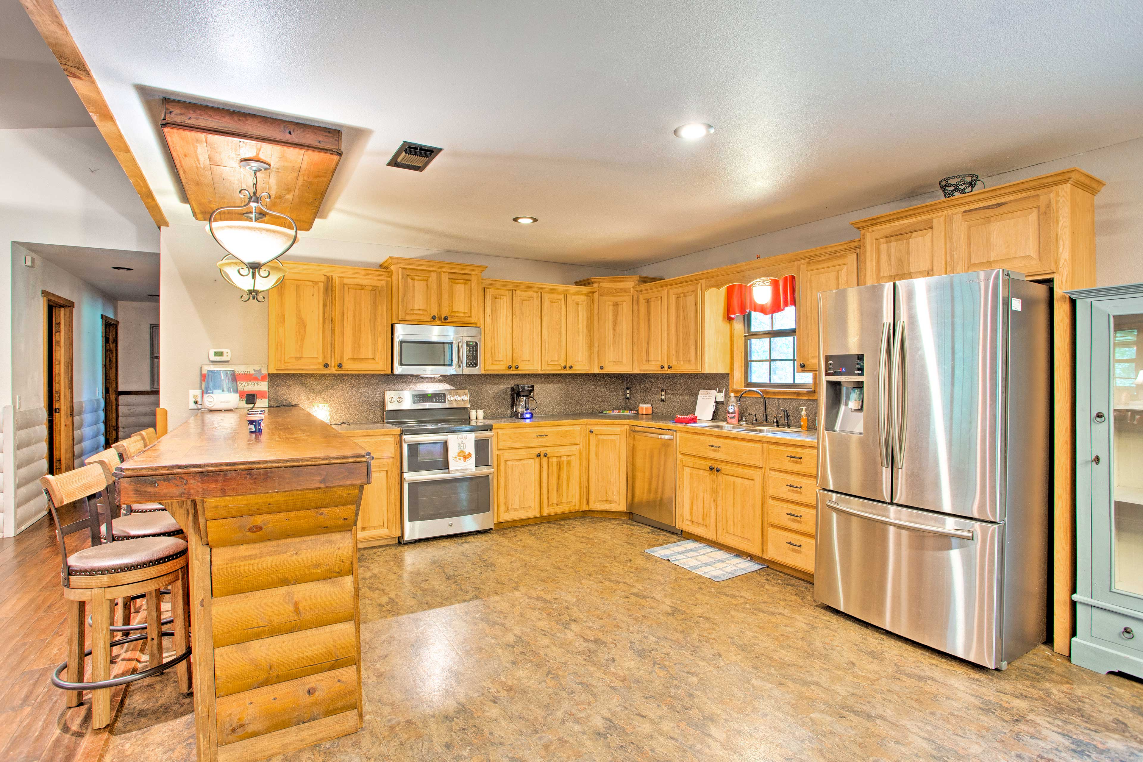Stainless steel appliances complement the wood cabinetry.