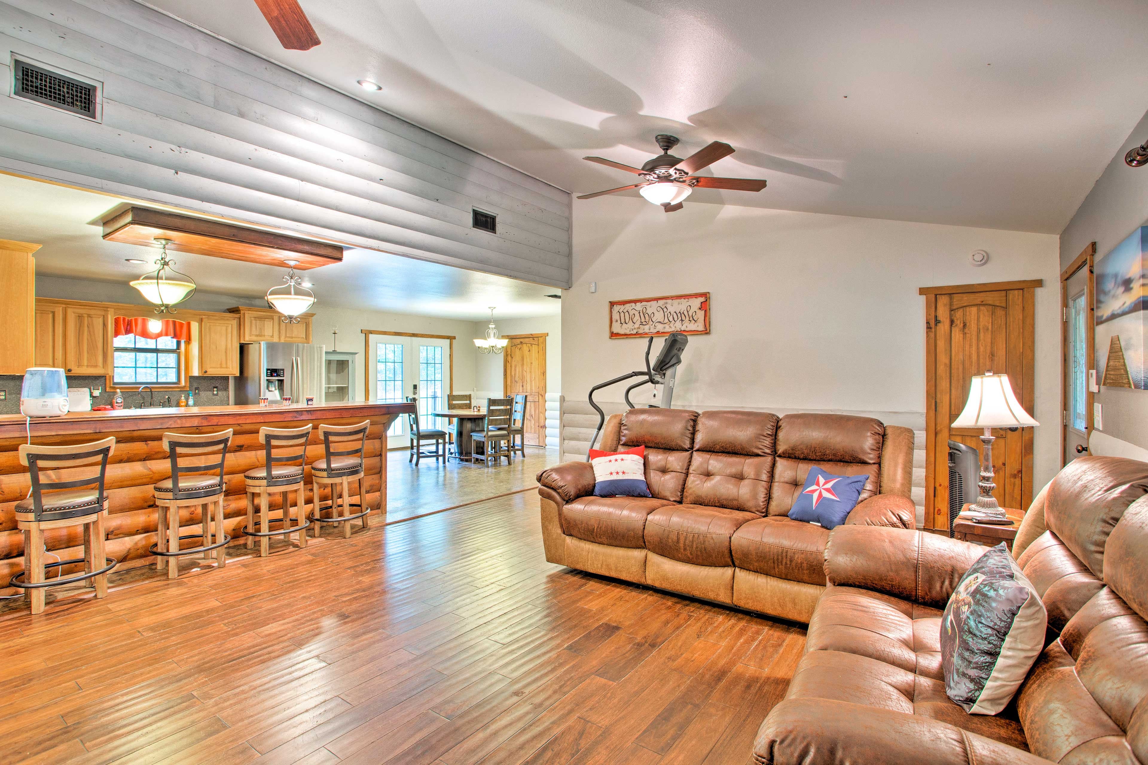 There's plenty of seating for everyone with 2 couches & a bar for 4.