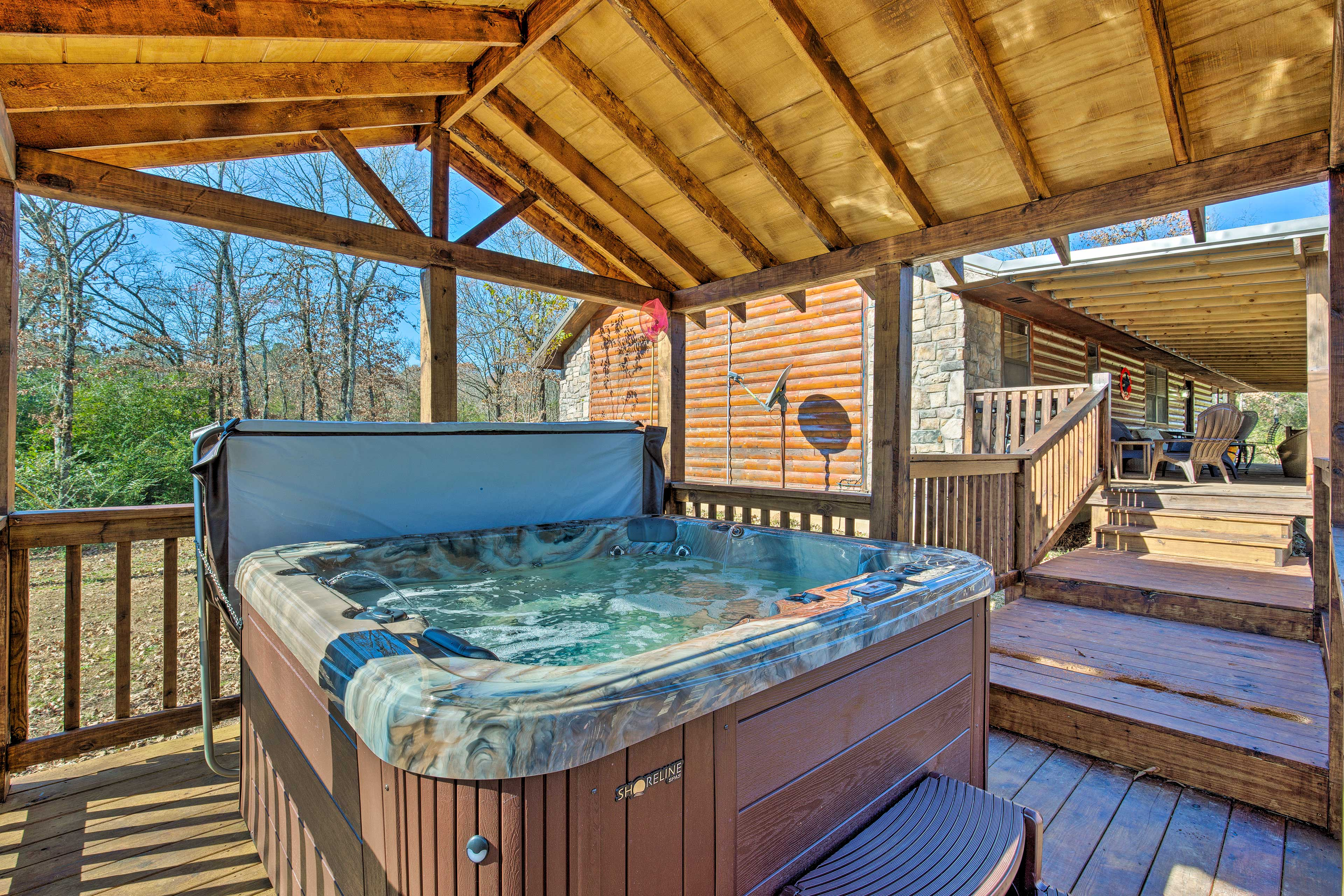 Loosen your muscles in the private covered hot tub.