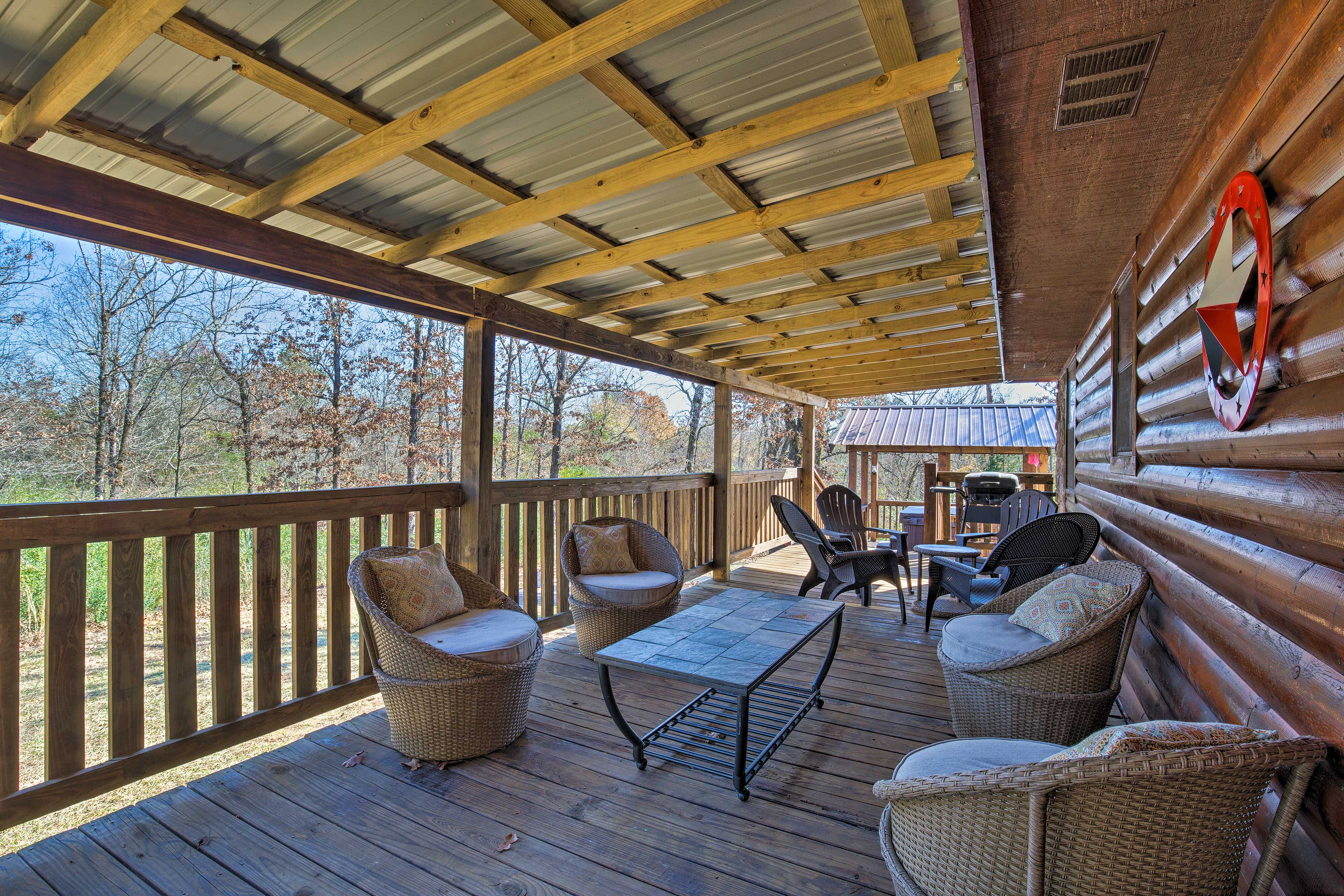Unwind with your loved ones on the expansive front porch while grilling dinner!
