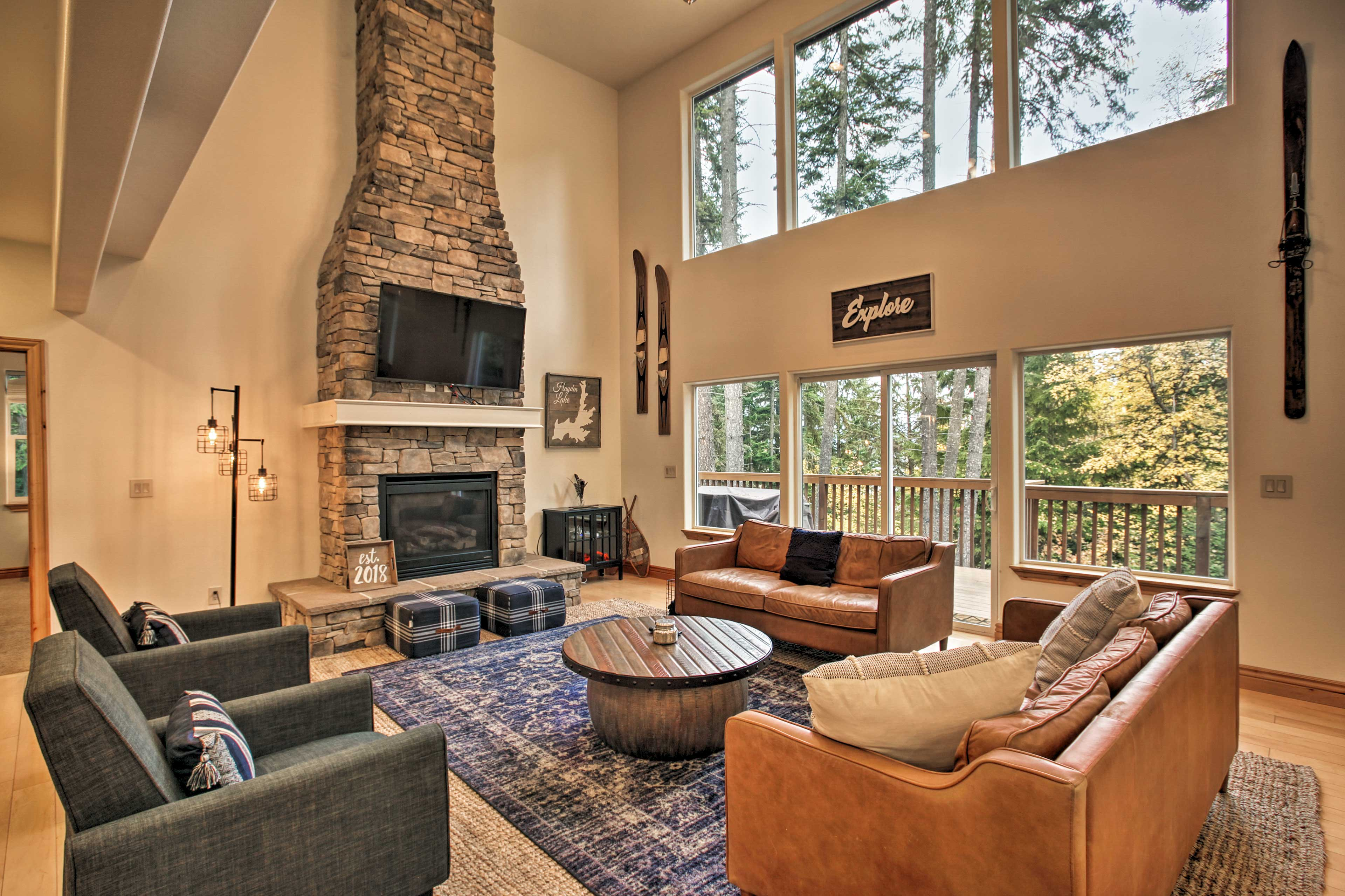 Experience Hayden Lake in luxury at this upscale vacation rental lake house!