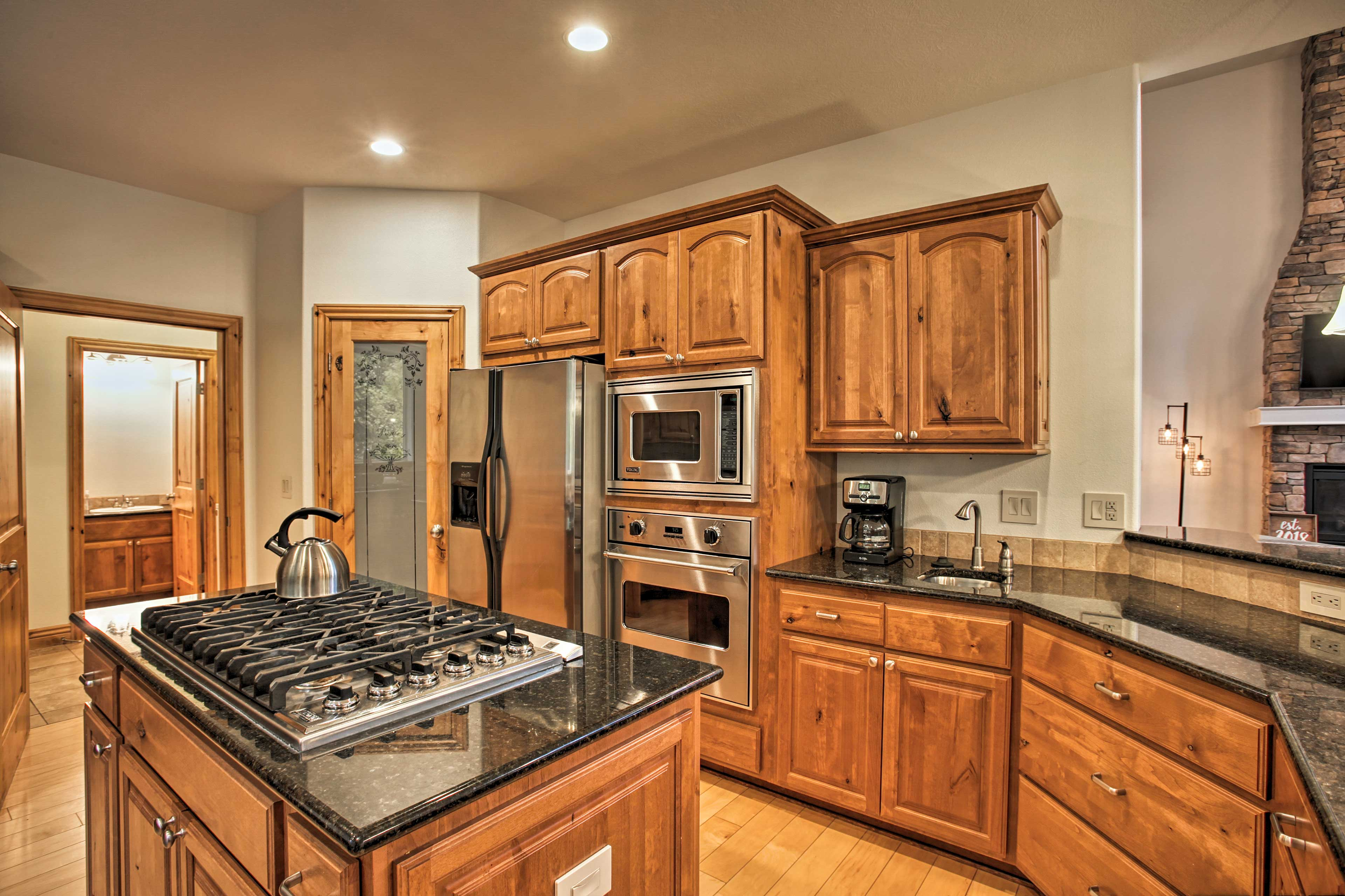 Stainless steel appliances & gorgeous wood cabinets enhance the stylish kitchen.