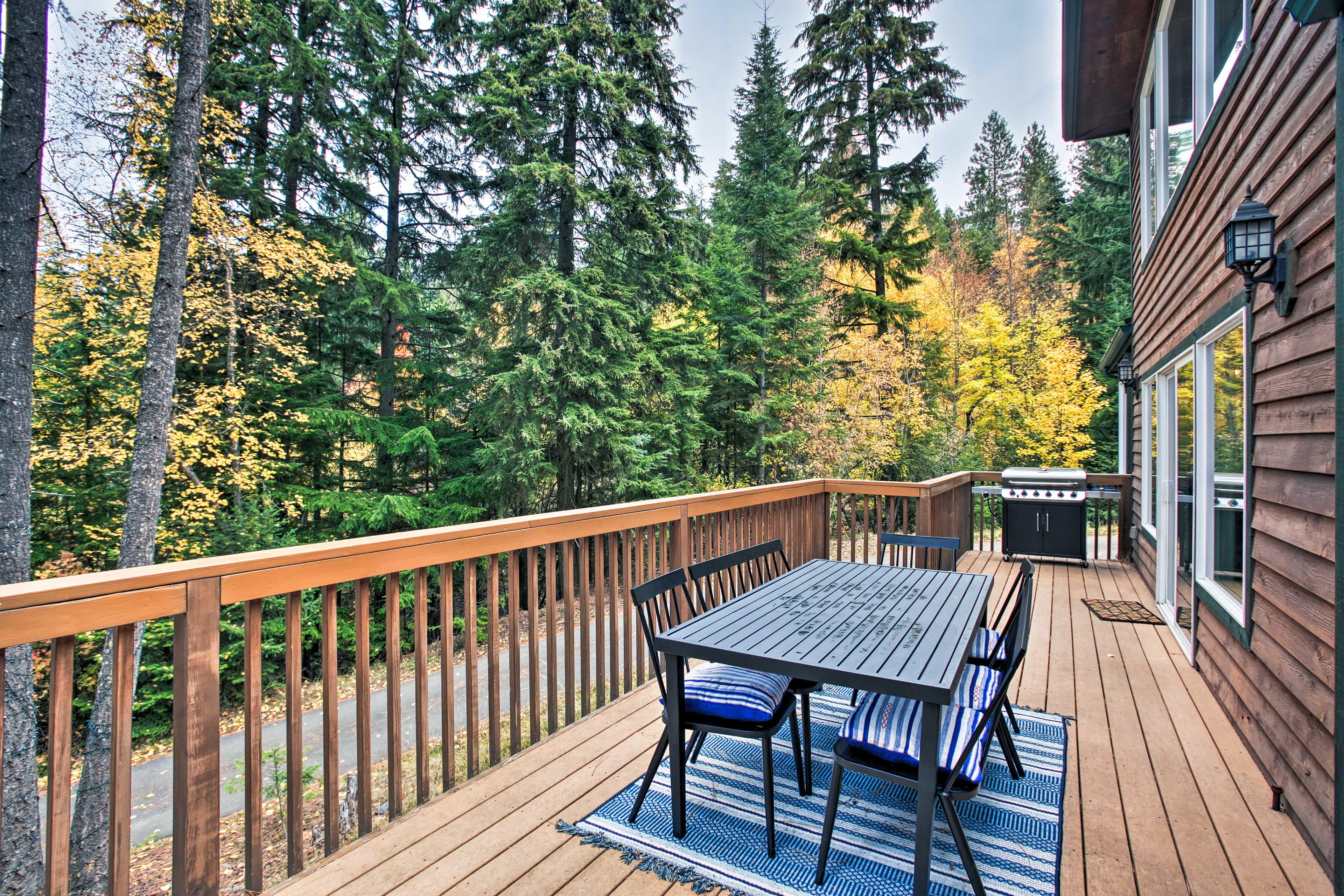 Secluded by trees & 3 minutes from the marina, this home's location is ideal.