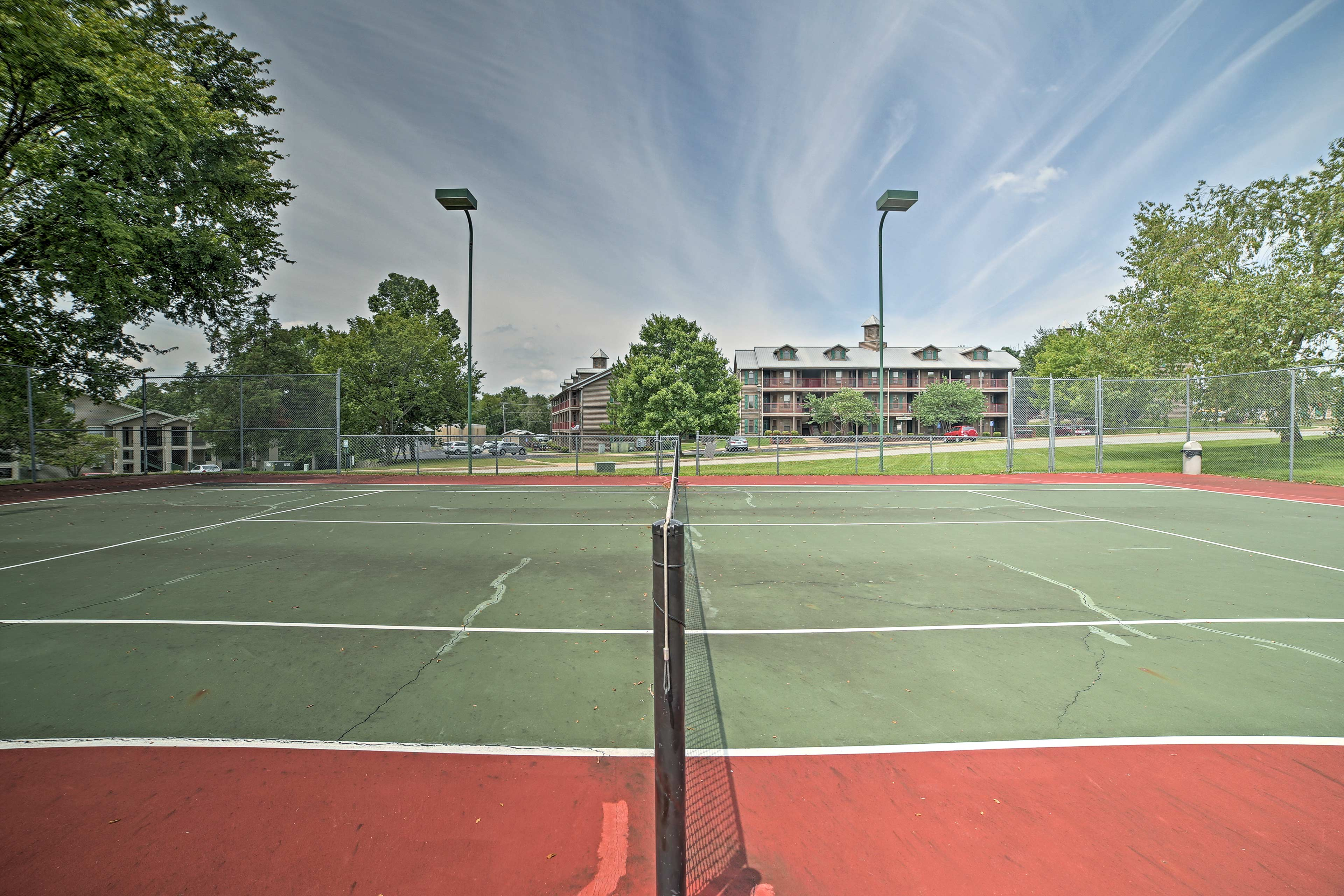 Team up for a doubles match on the tennis courts.