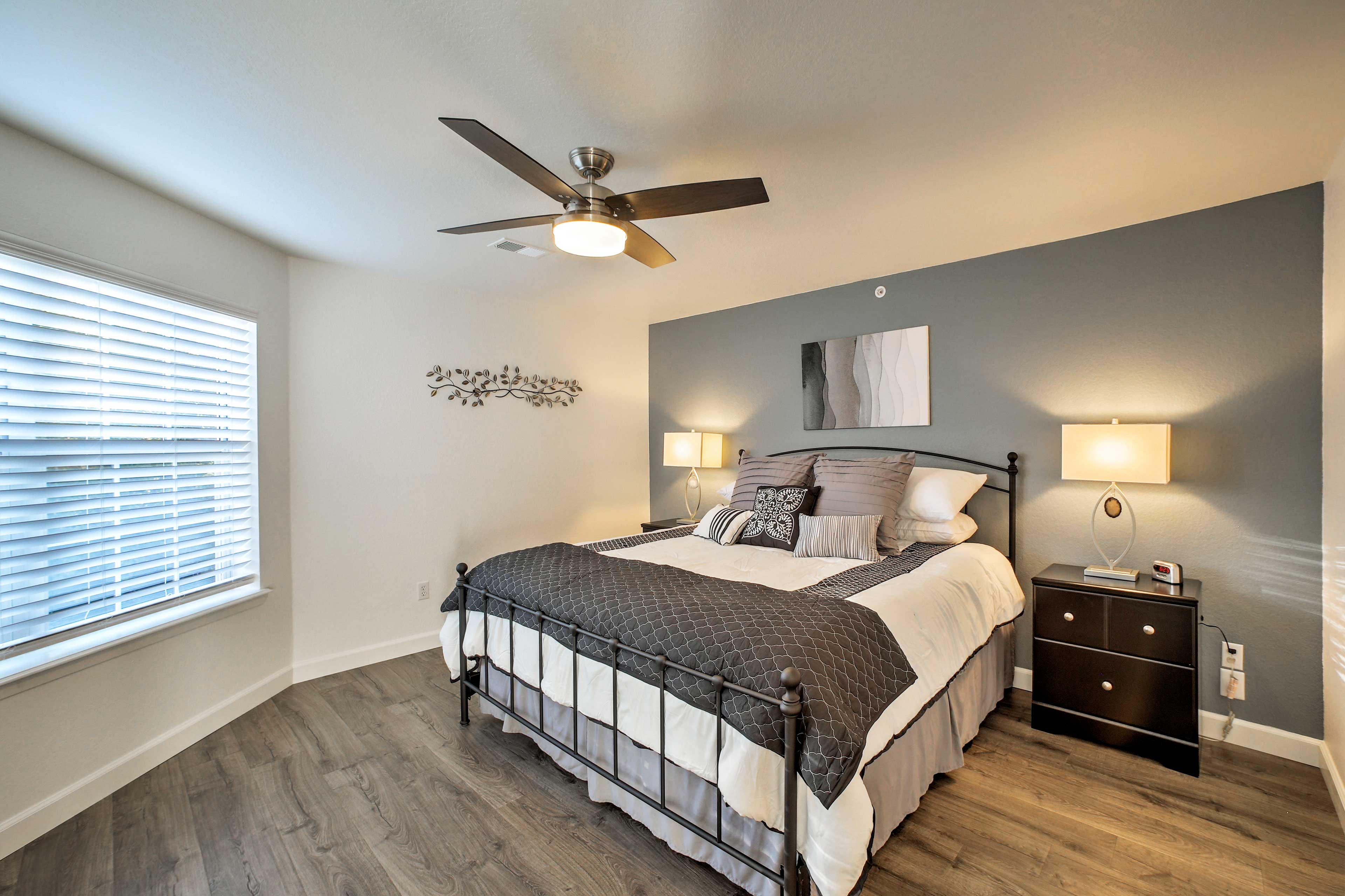 The master bedroom also houses a king-sized bed.