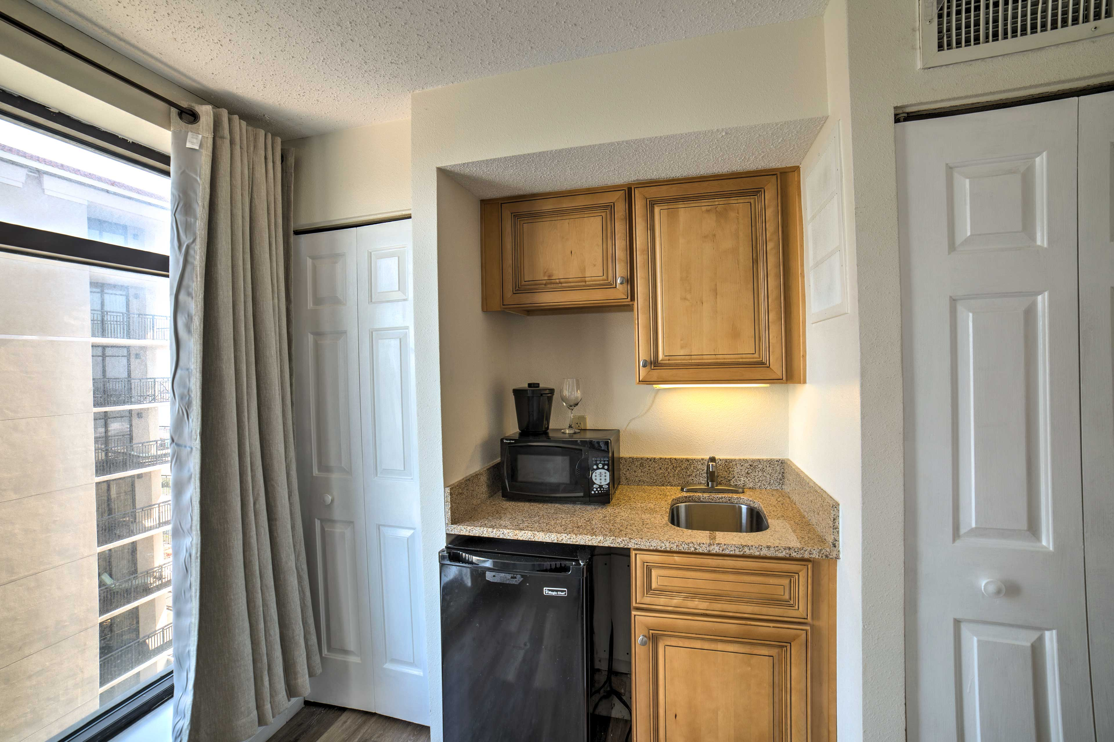 Custom wood cabinets complete the kitchenette.