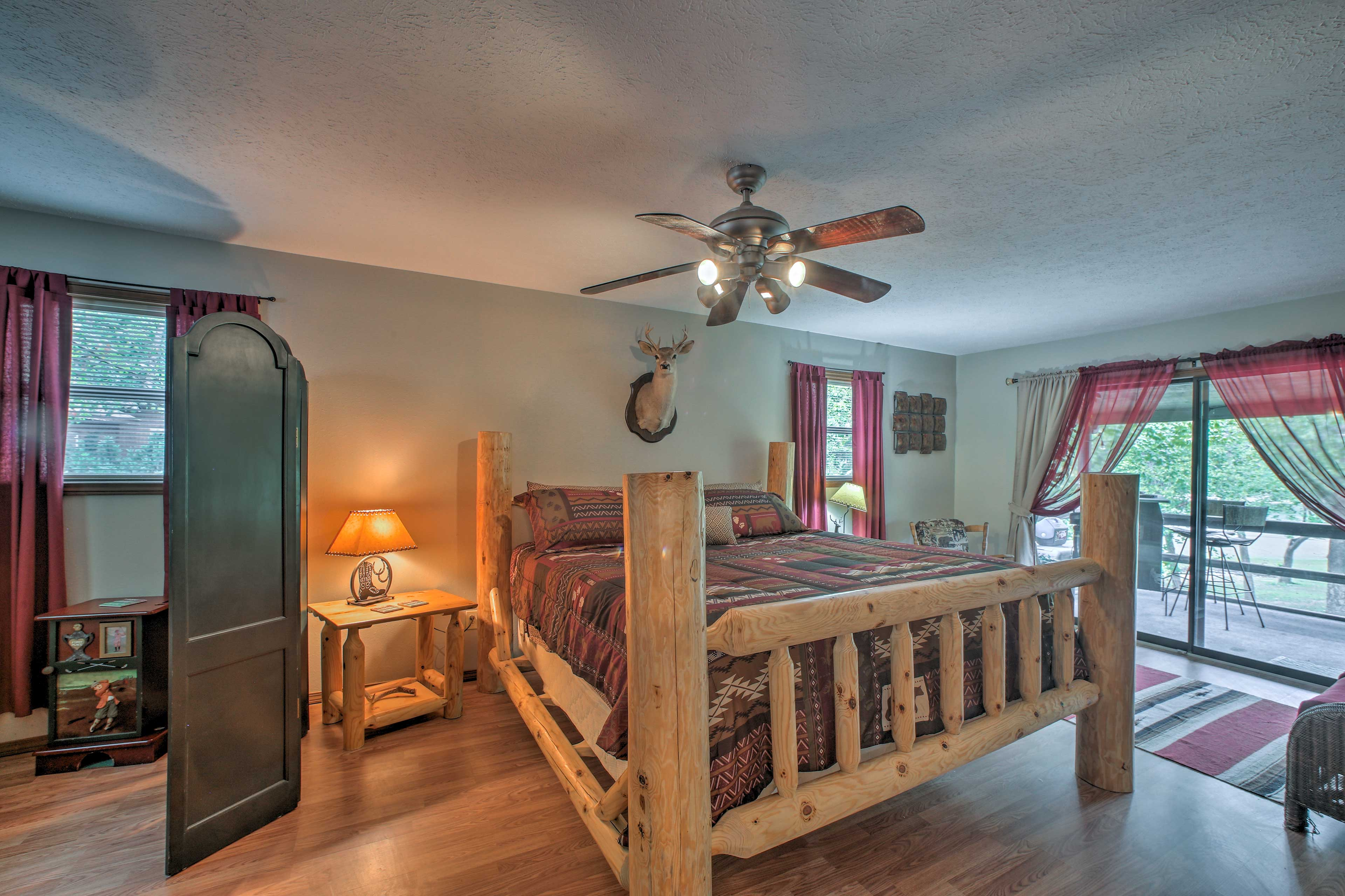 The master bedroom boasts a king bed and private access to the porch.