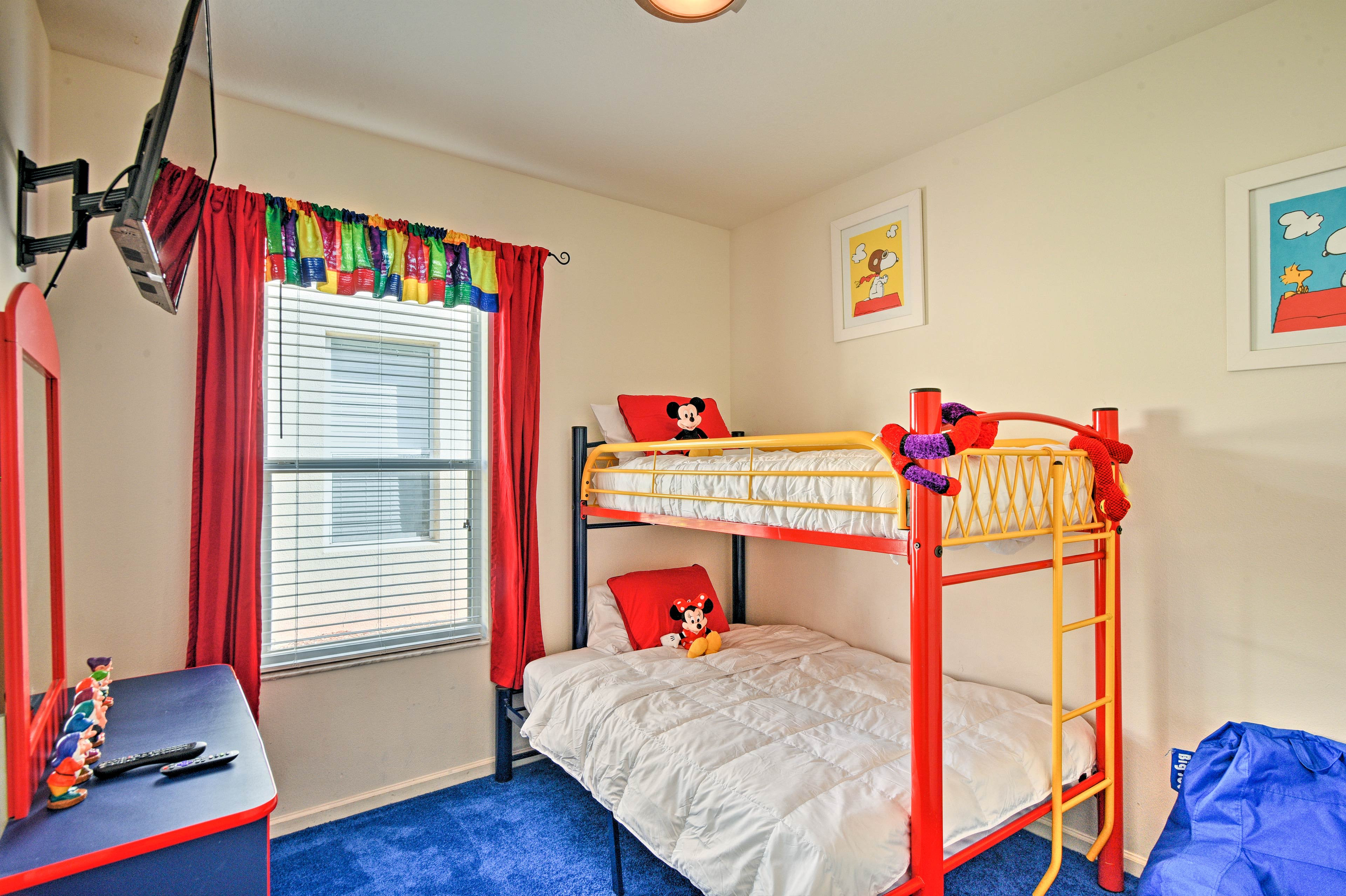 Kids will love this disney-themed room with a bunk set.