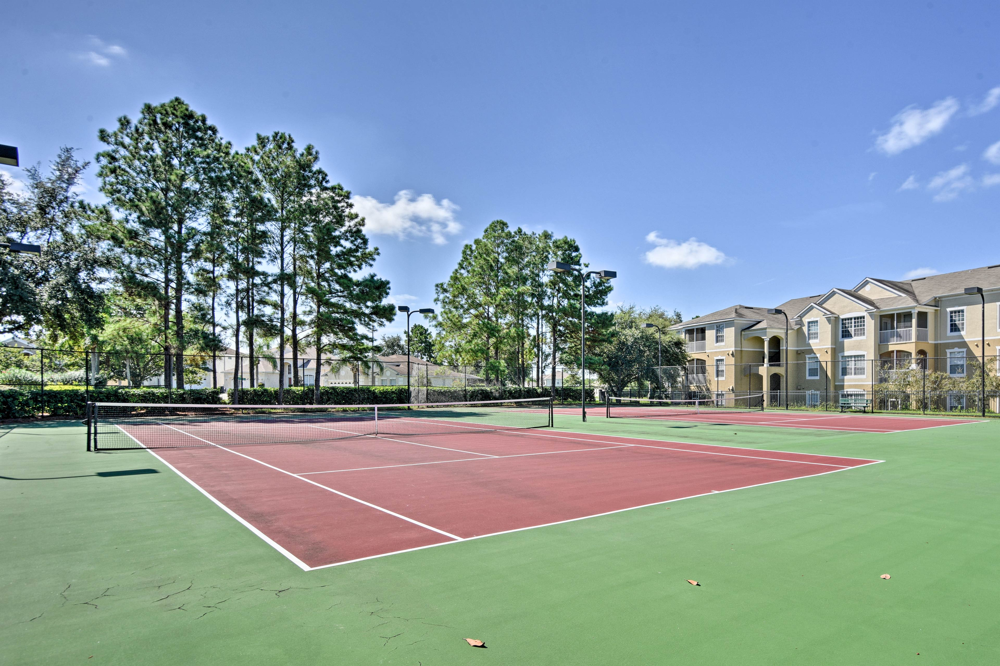A friendly match of tennis is the perfect workout in the early afternoon.