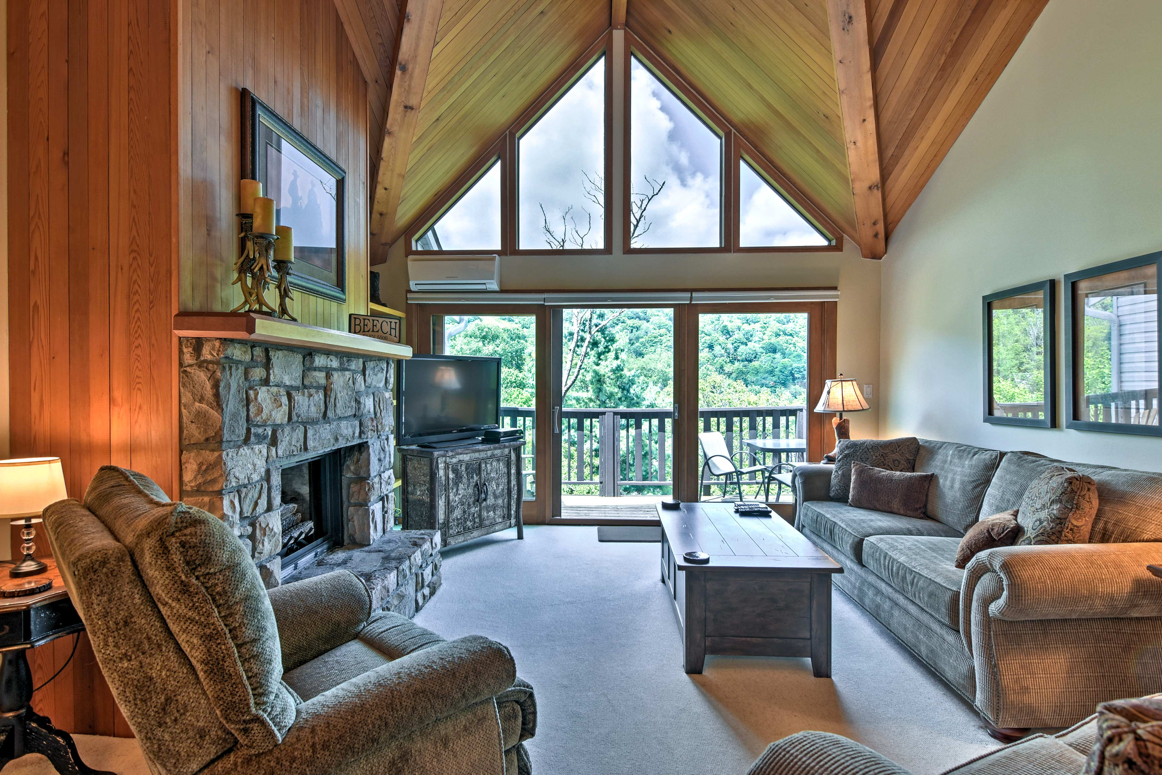 Natural light spills in through the wall of windows exposing the wood ceilings.