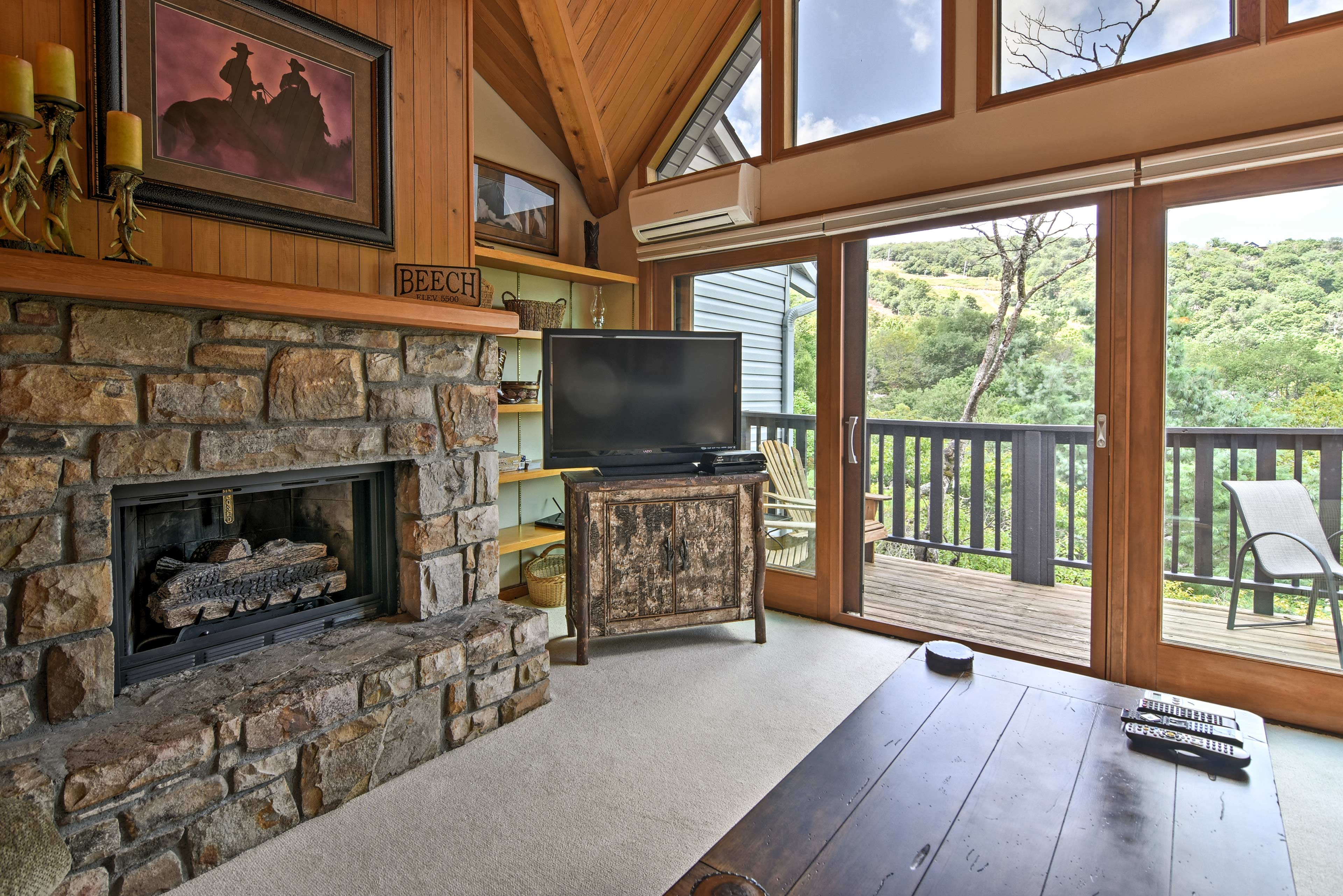 Warm up by the gas fireplace while you watch the flat-screen cable TV.
