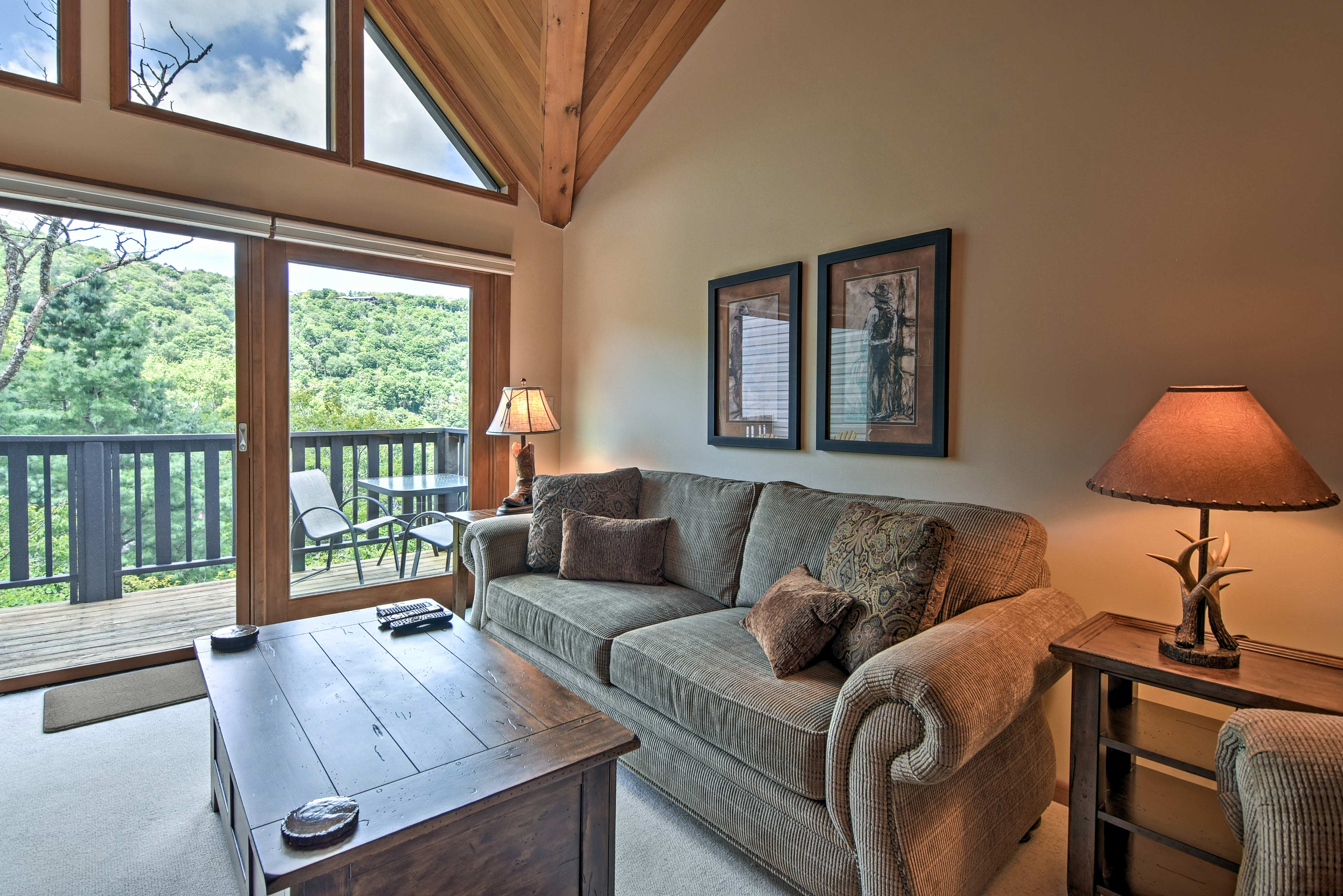Knotty pine walls and charming mountain decor complete the look inside.