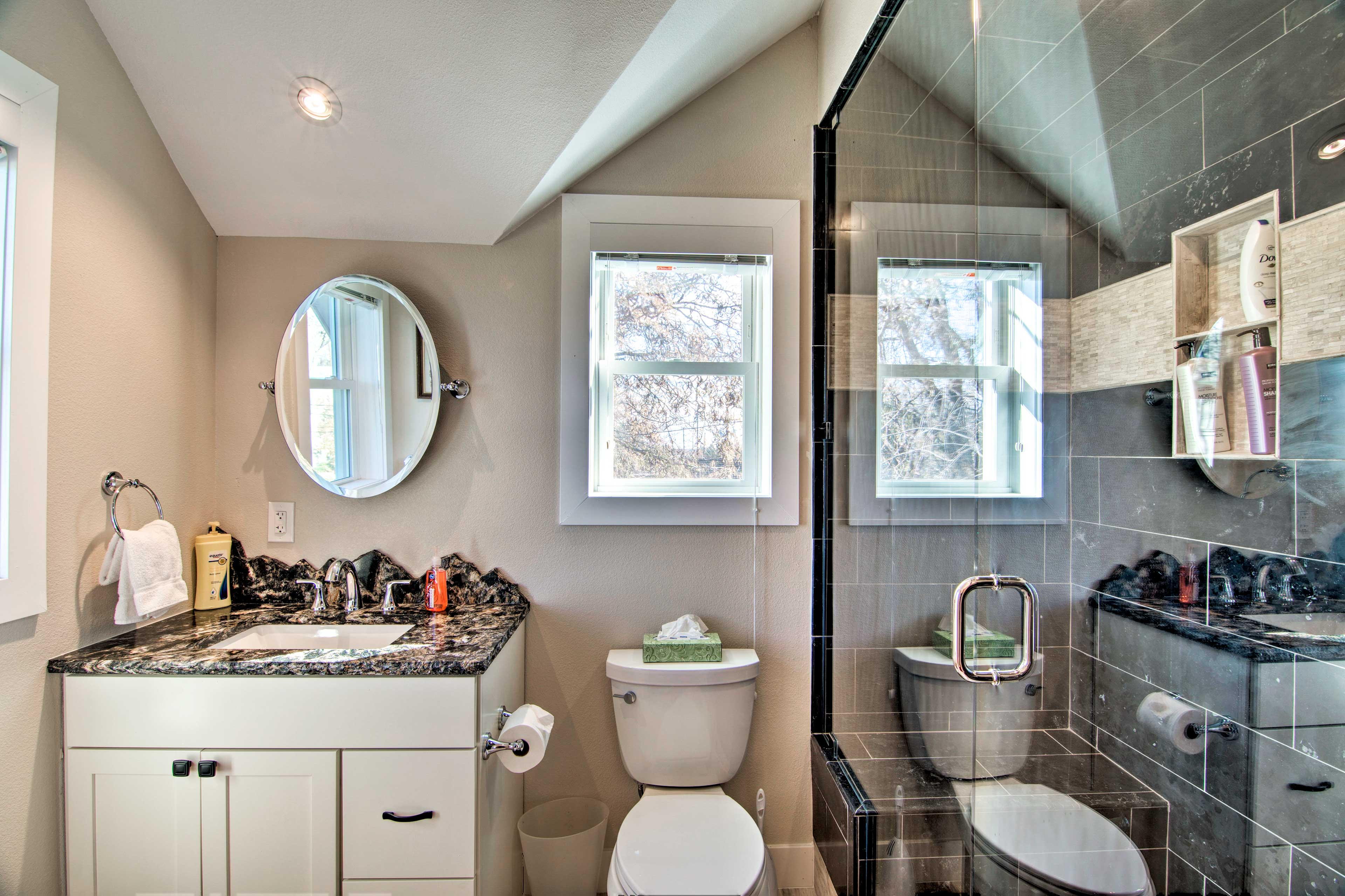 The bathroom houses a large walk-in shower.