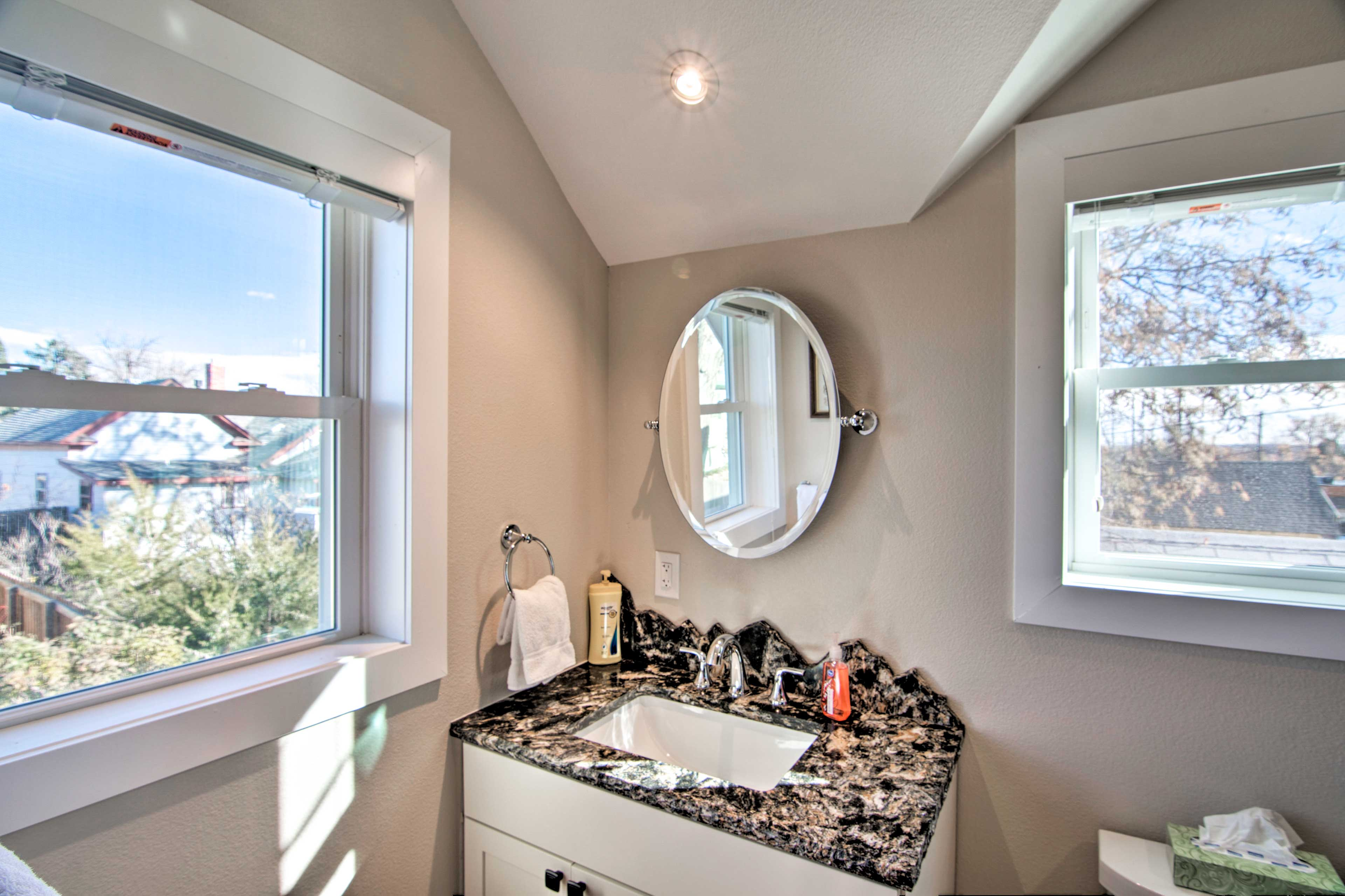 Easily get ready at the mirrored vanity.