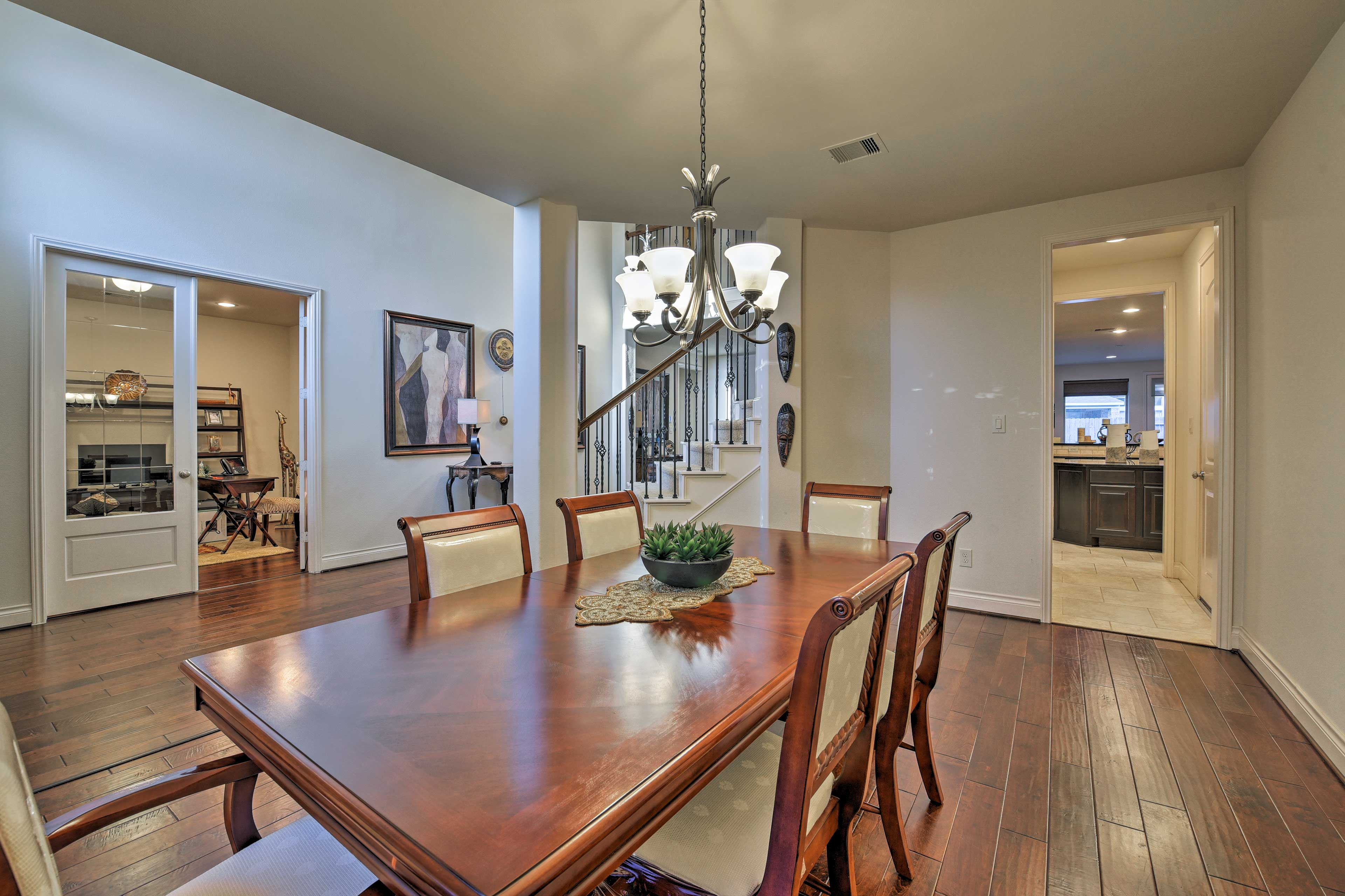 The formal dining area features an elegant 6-person table.