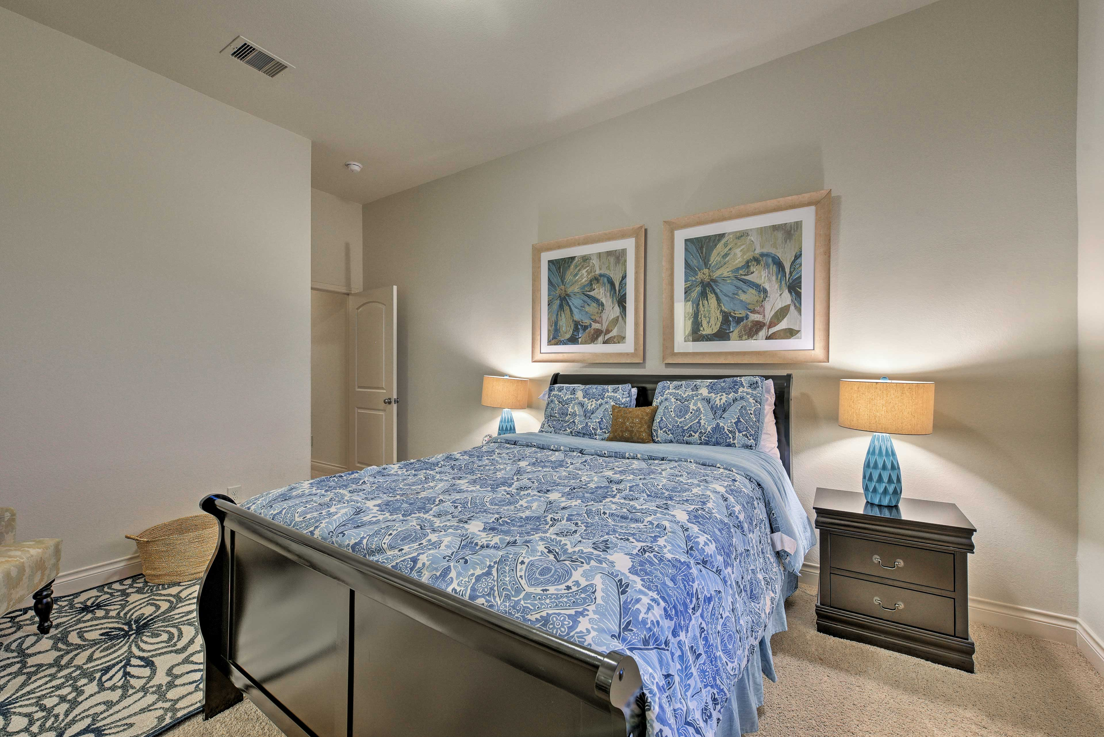 A beautiful blue comforter highlights this bedroom.