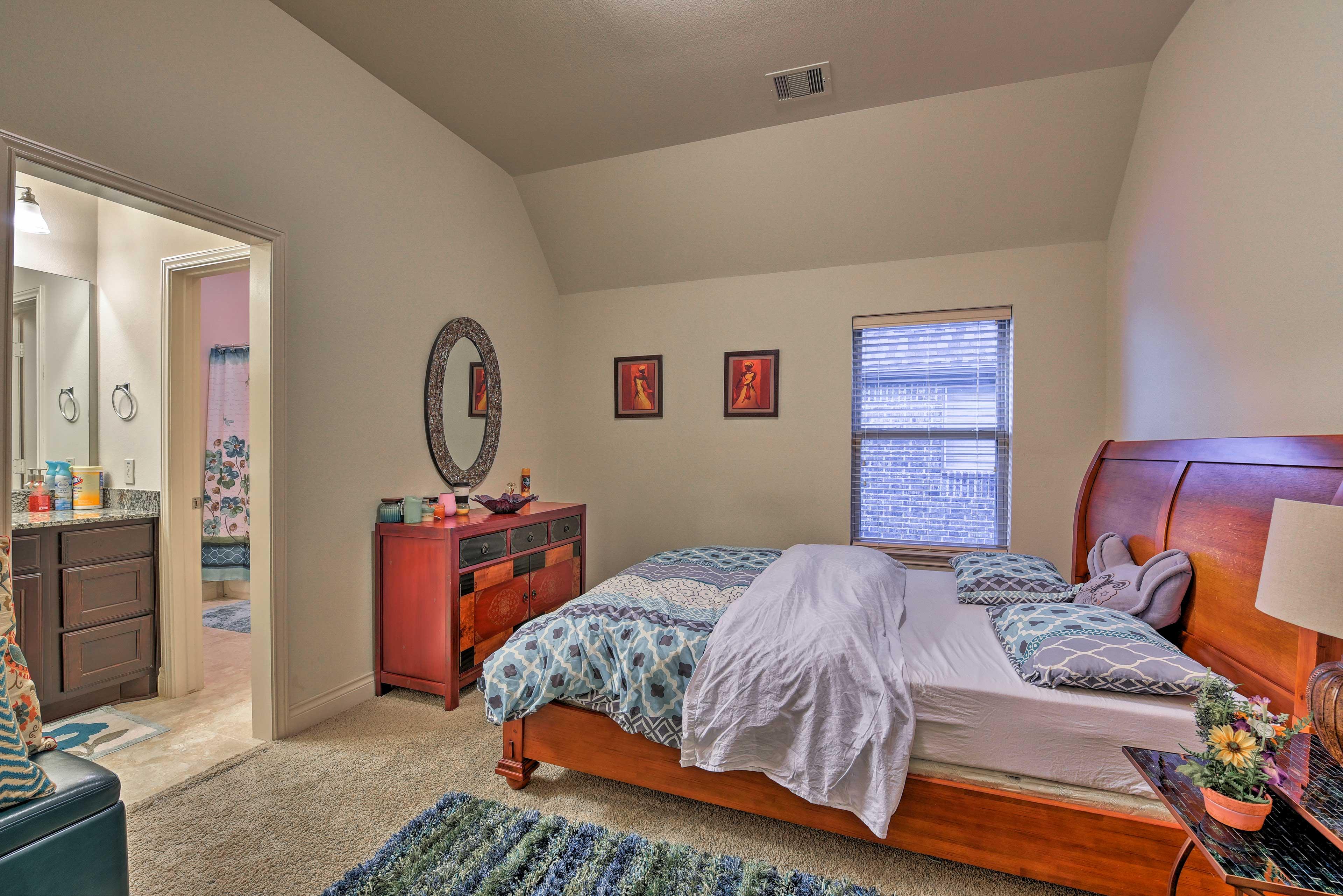 This bedroom offers an en-suite Jack-and-Jill bathroom.
