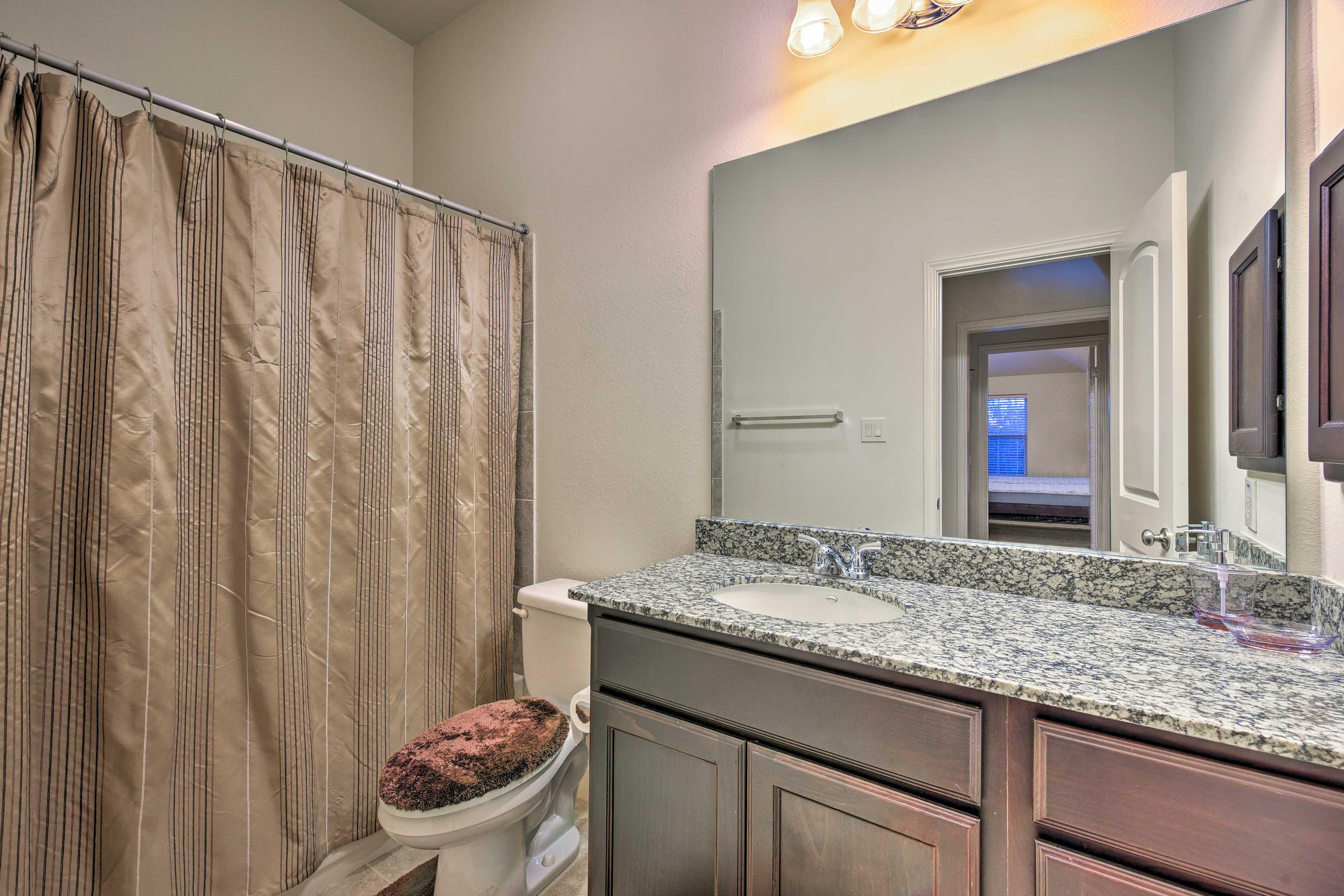 The third bathroom houses a shower/tub combo.