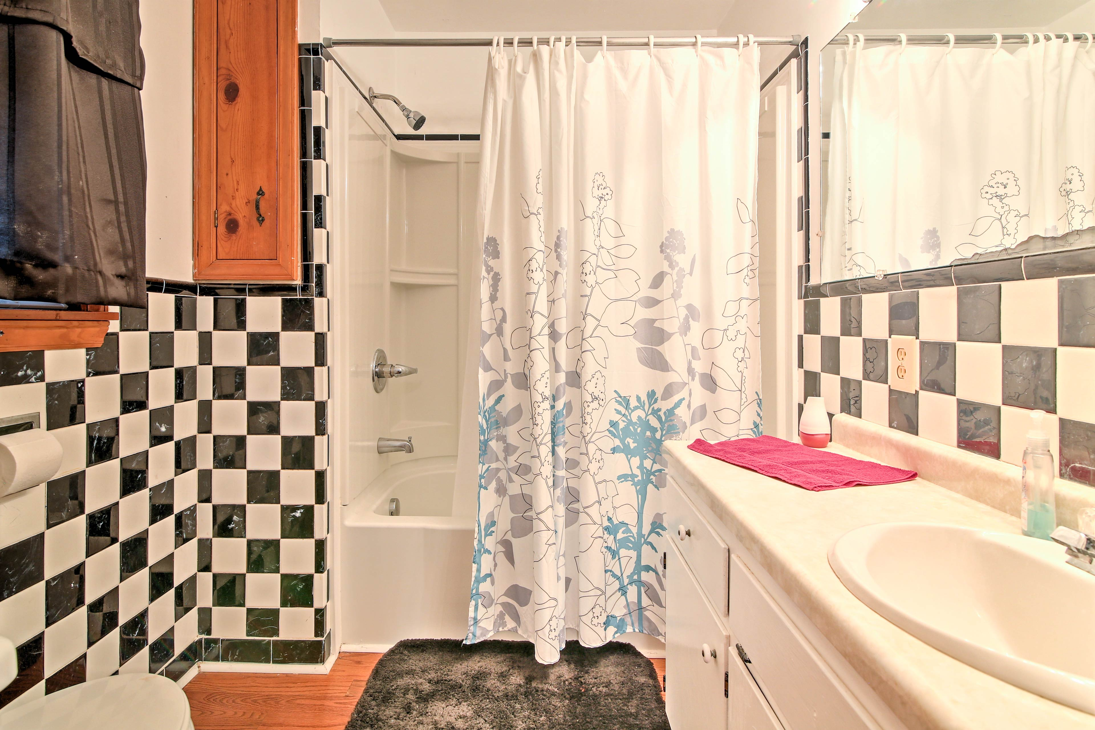 The second full bathroom is equipped with a shower/tub combo.