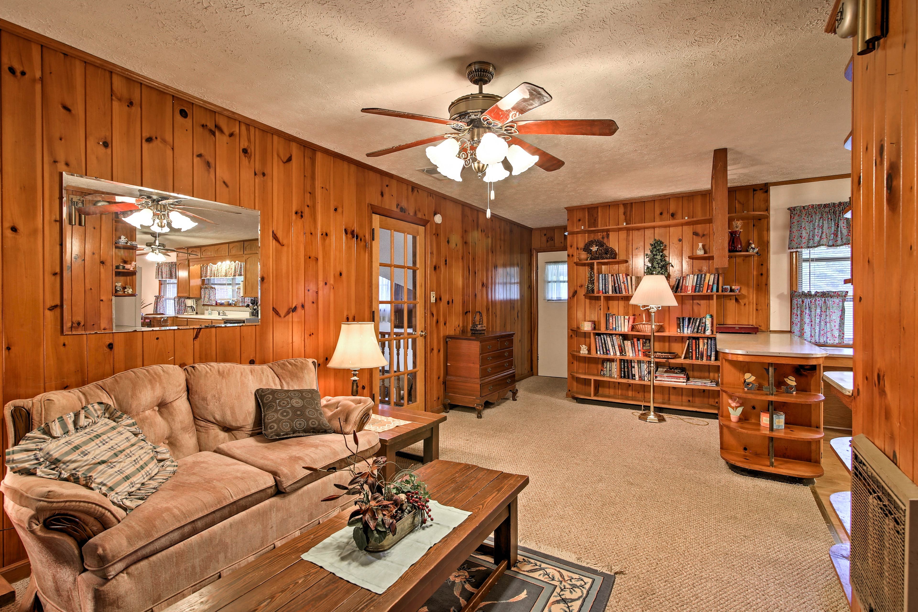 The 1,800-square-foot interior hosts cozy wood paneling & the comforts of home.
