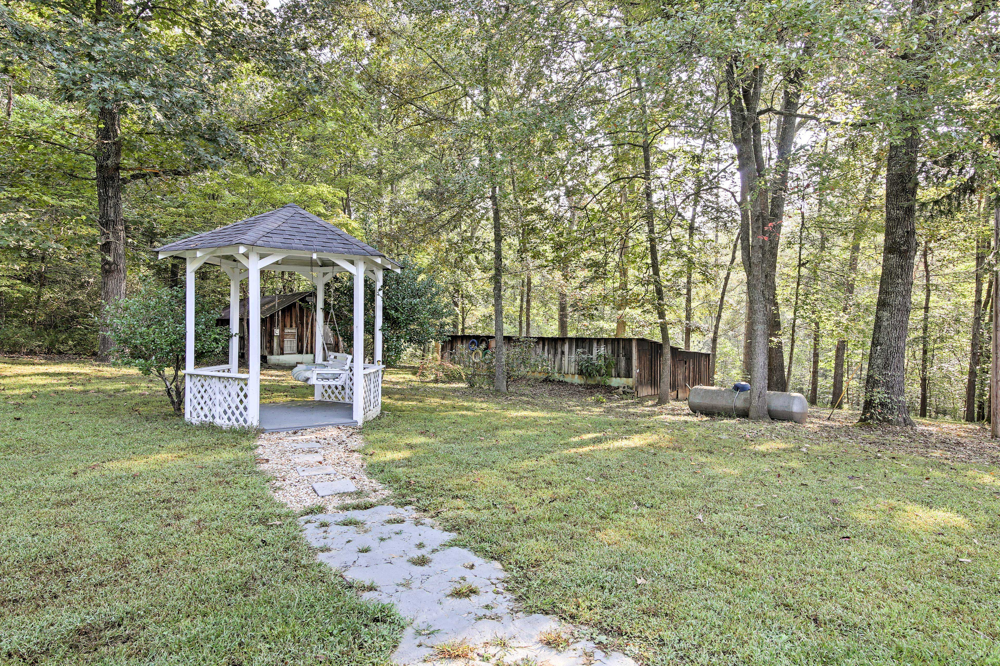 Stroll over to the gazebo to do some reading on the swinging seat.