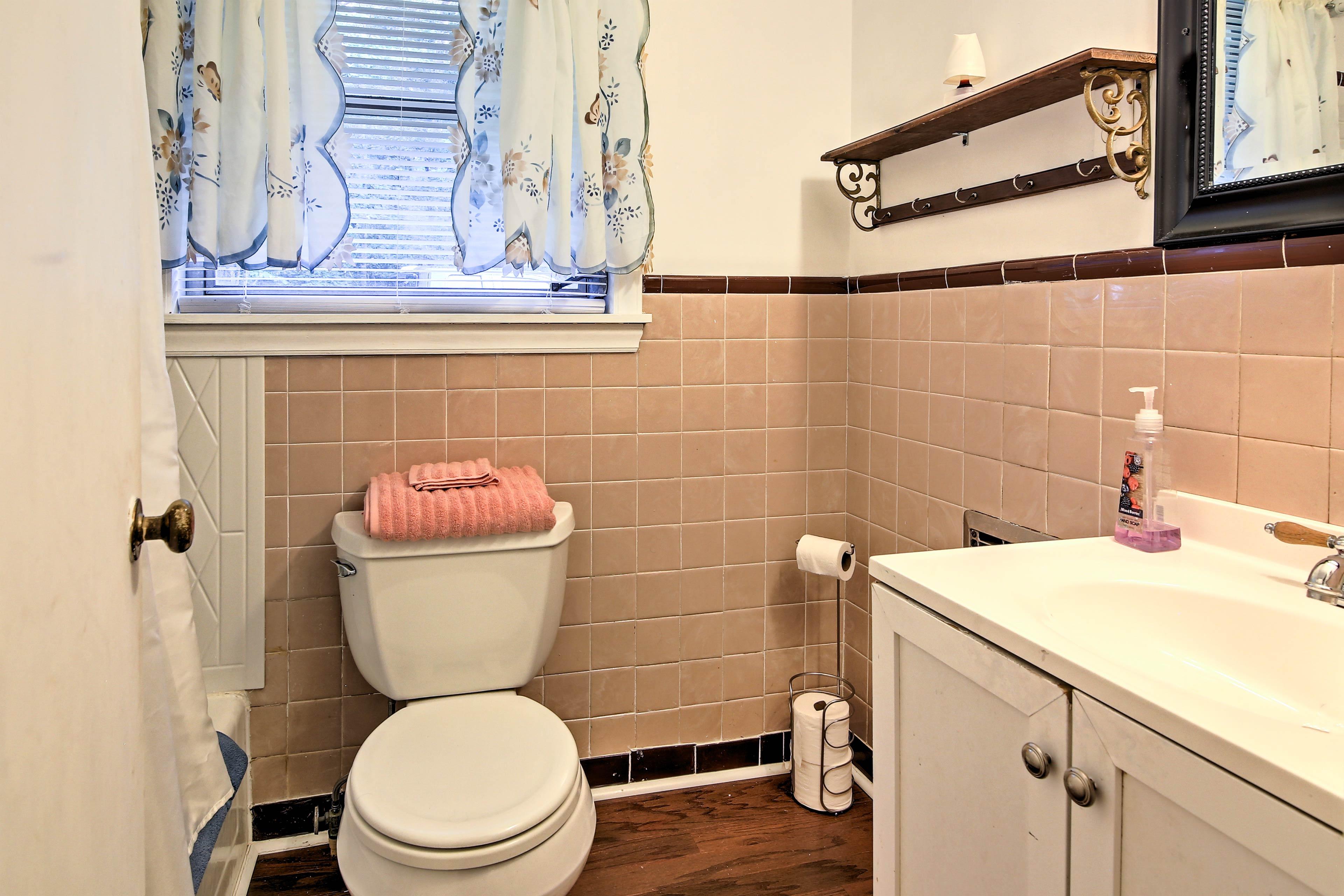 The en-suite bathroom boasts a shower/tub combo.
