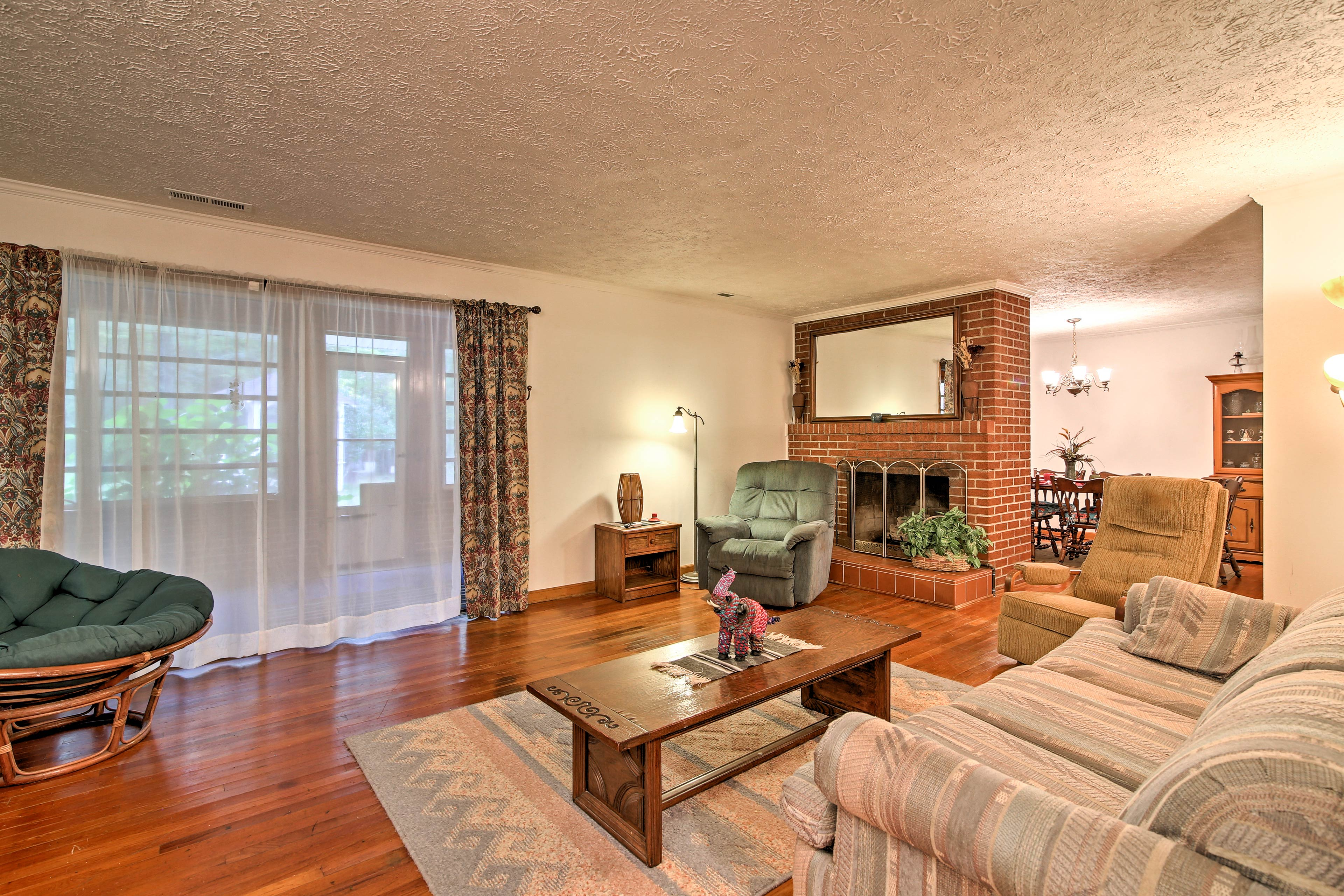 A second living area boasts gleaming hardwood floors and opens to the sunporch.