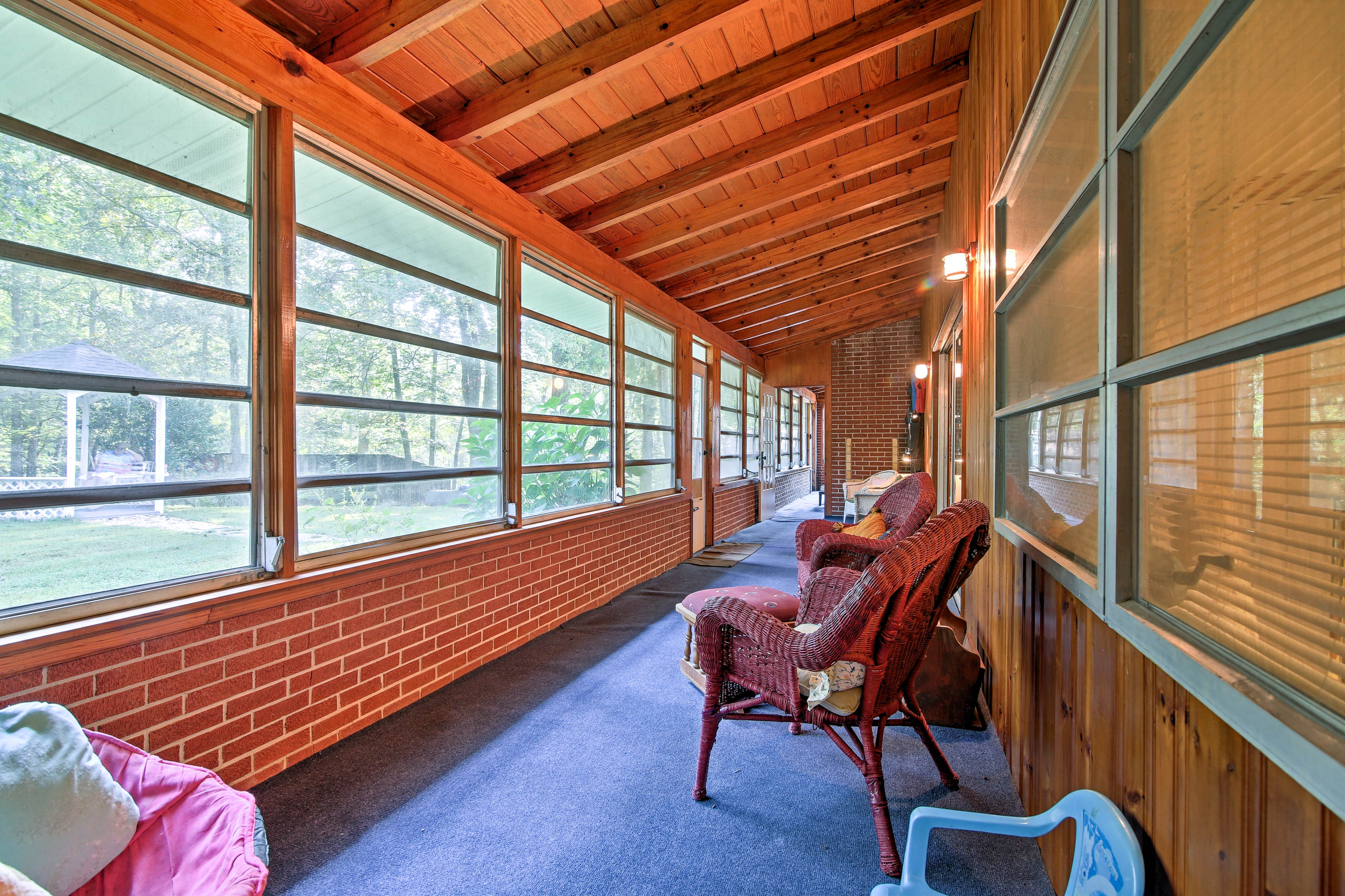 Unwind in the expansive screened-in porch.