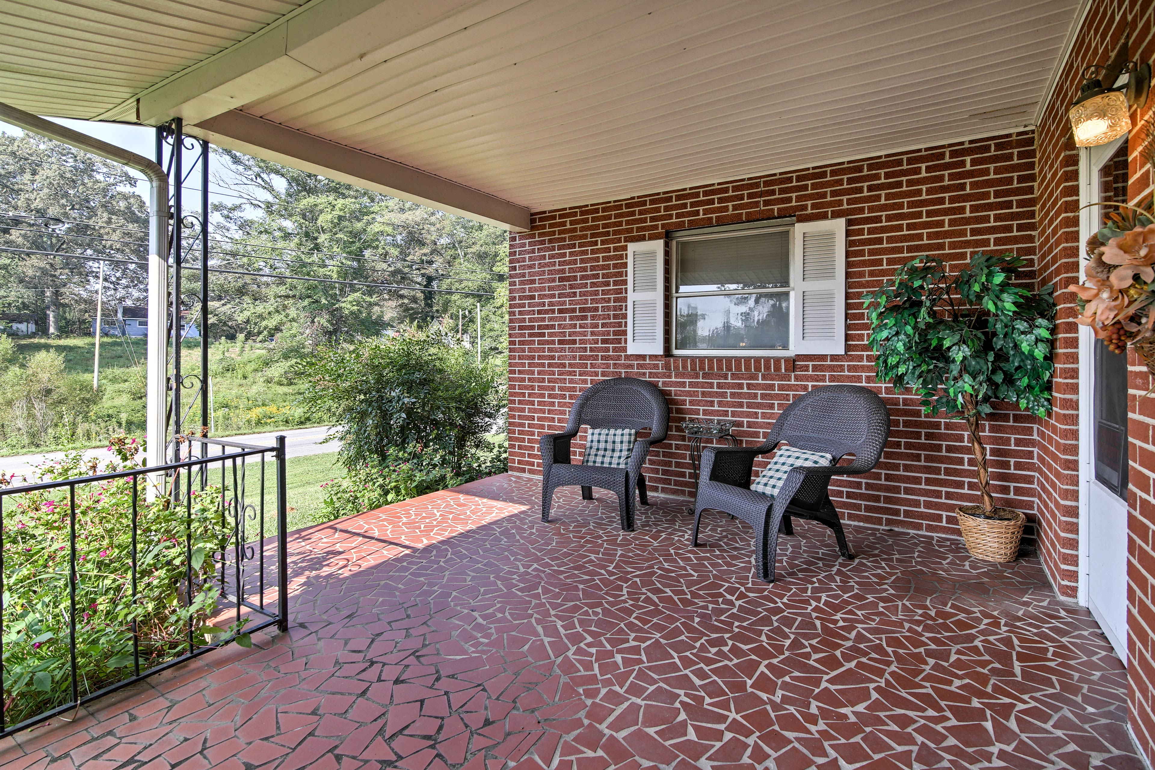 Take it easy on the spacious, covered front porch as you watch the world go by.