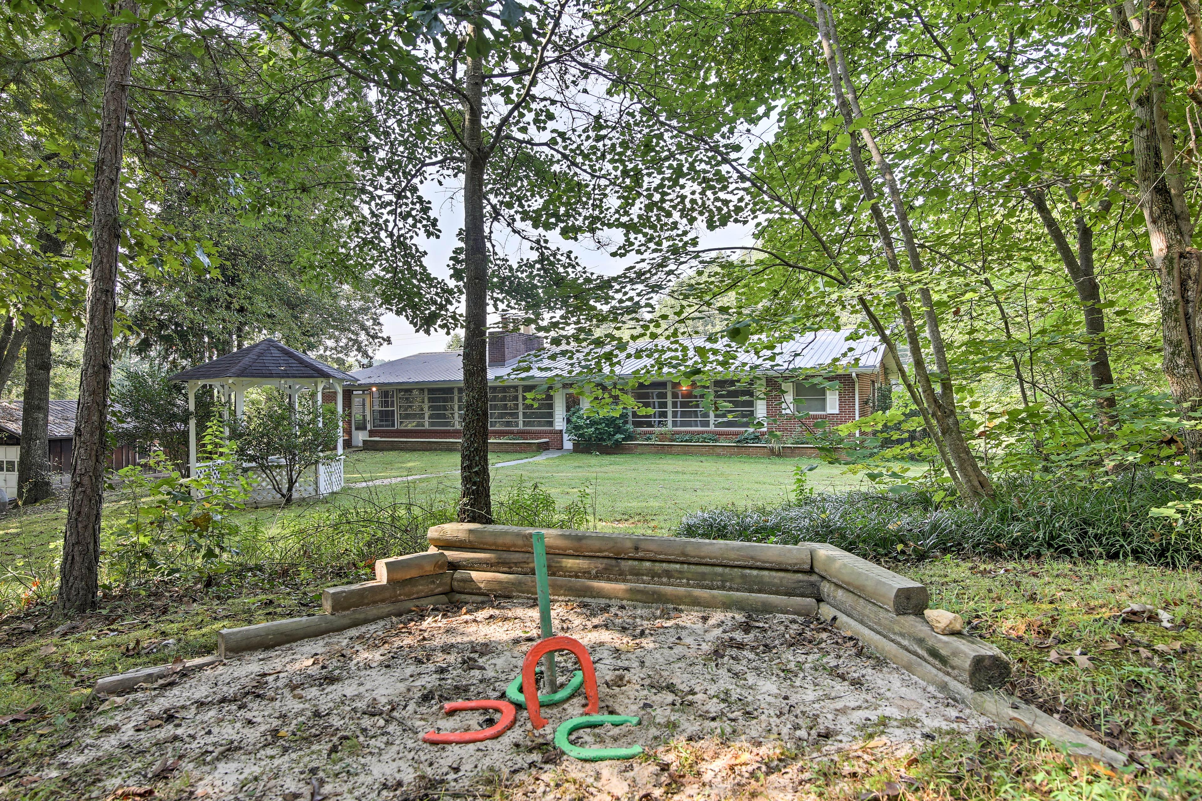The 5-acre property boasts a regulation-sized horseshoe pit.