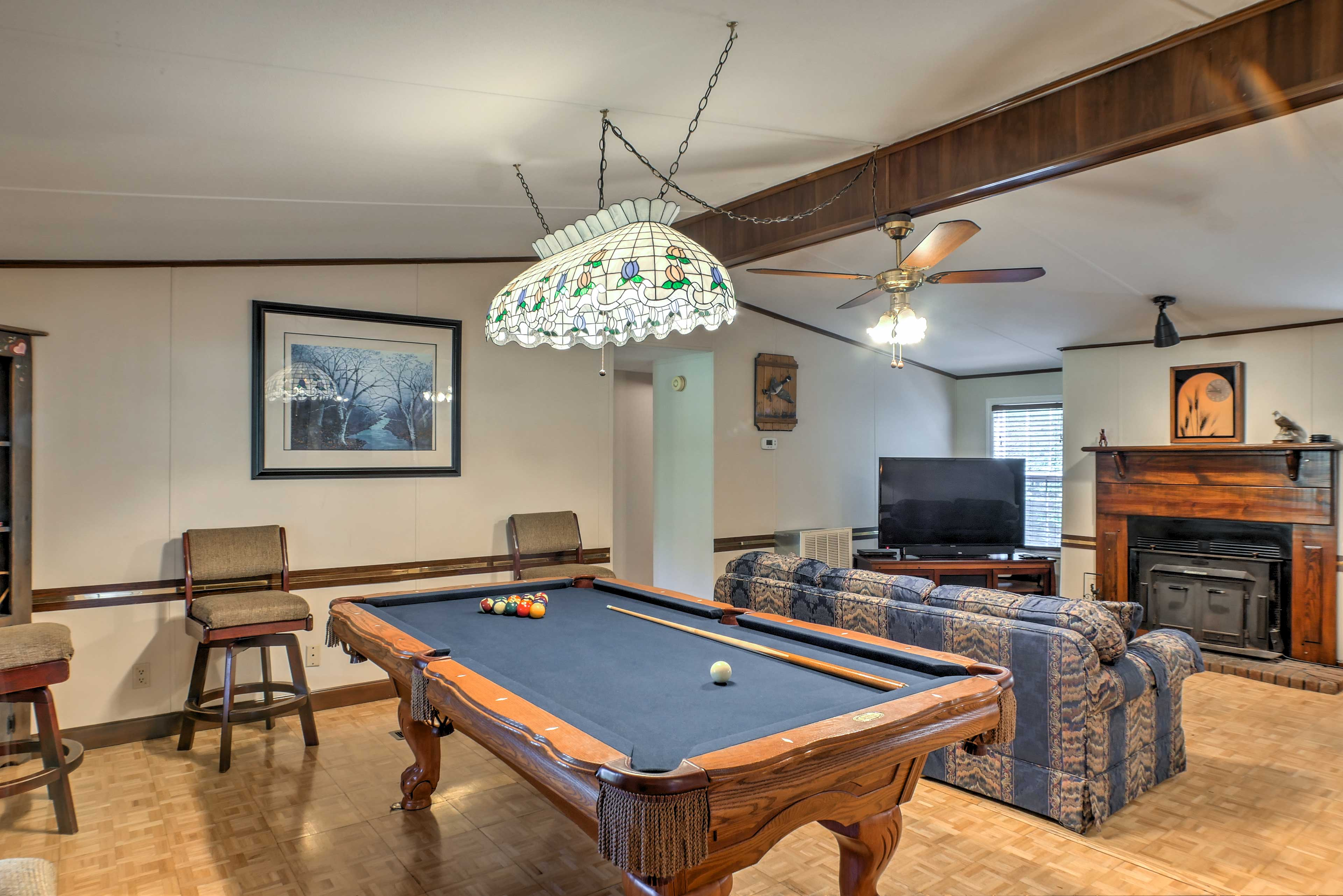 Hone your pool shots at the table in the living room.