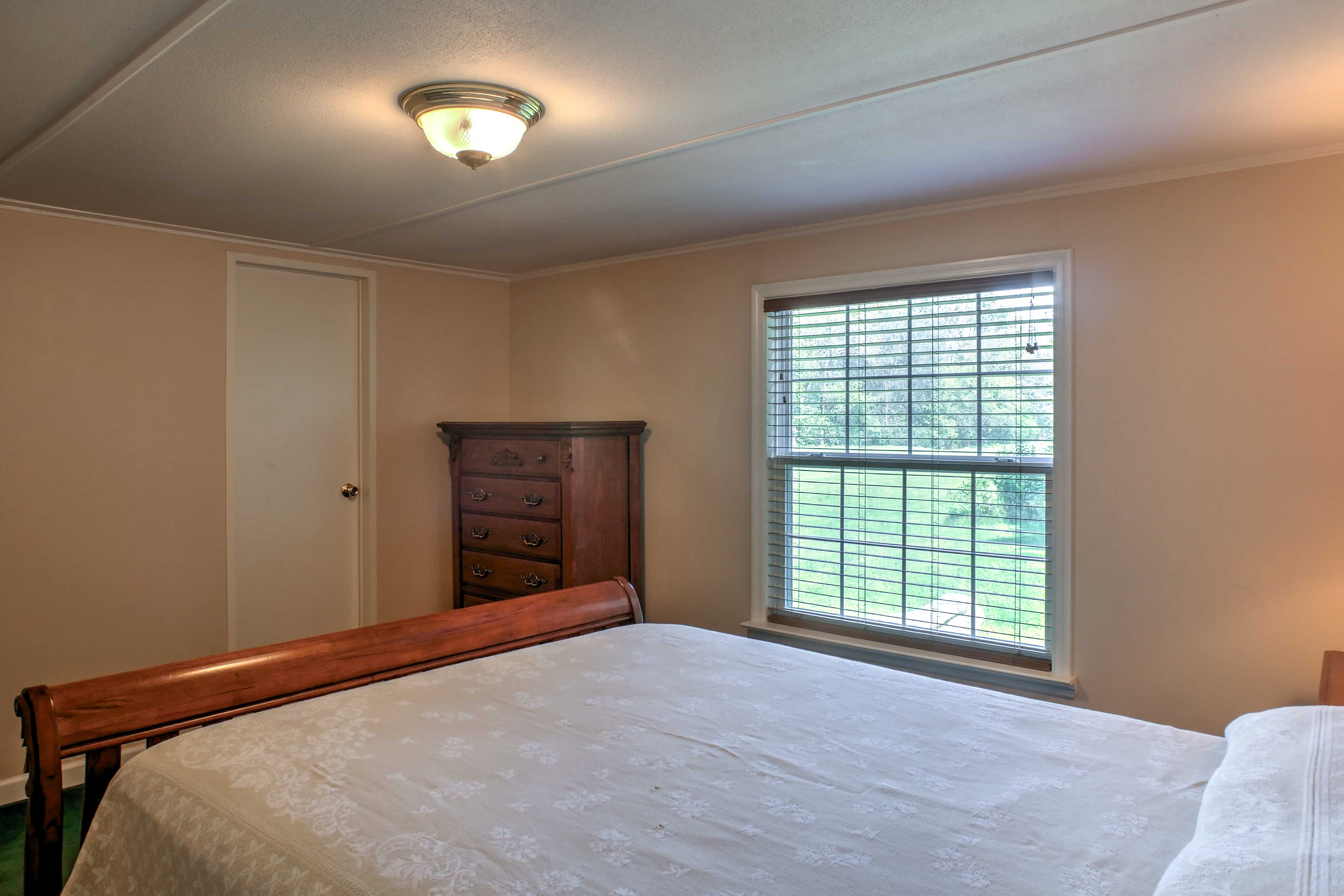 The window overlooks the expansive field in front of the property.
