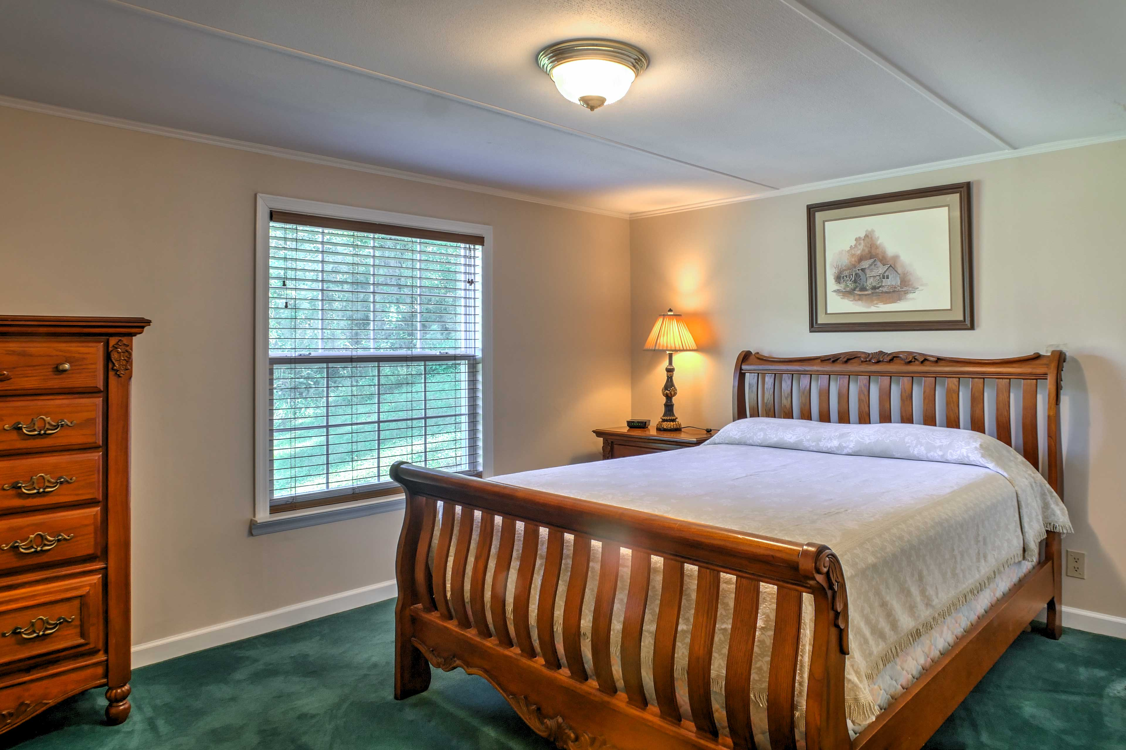 This bedroom hosts a plush queen bed.